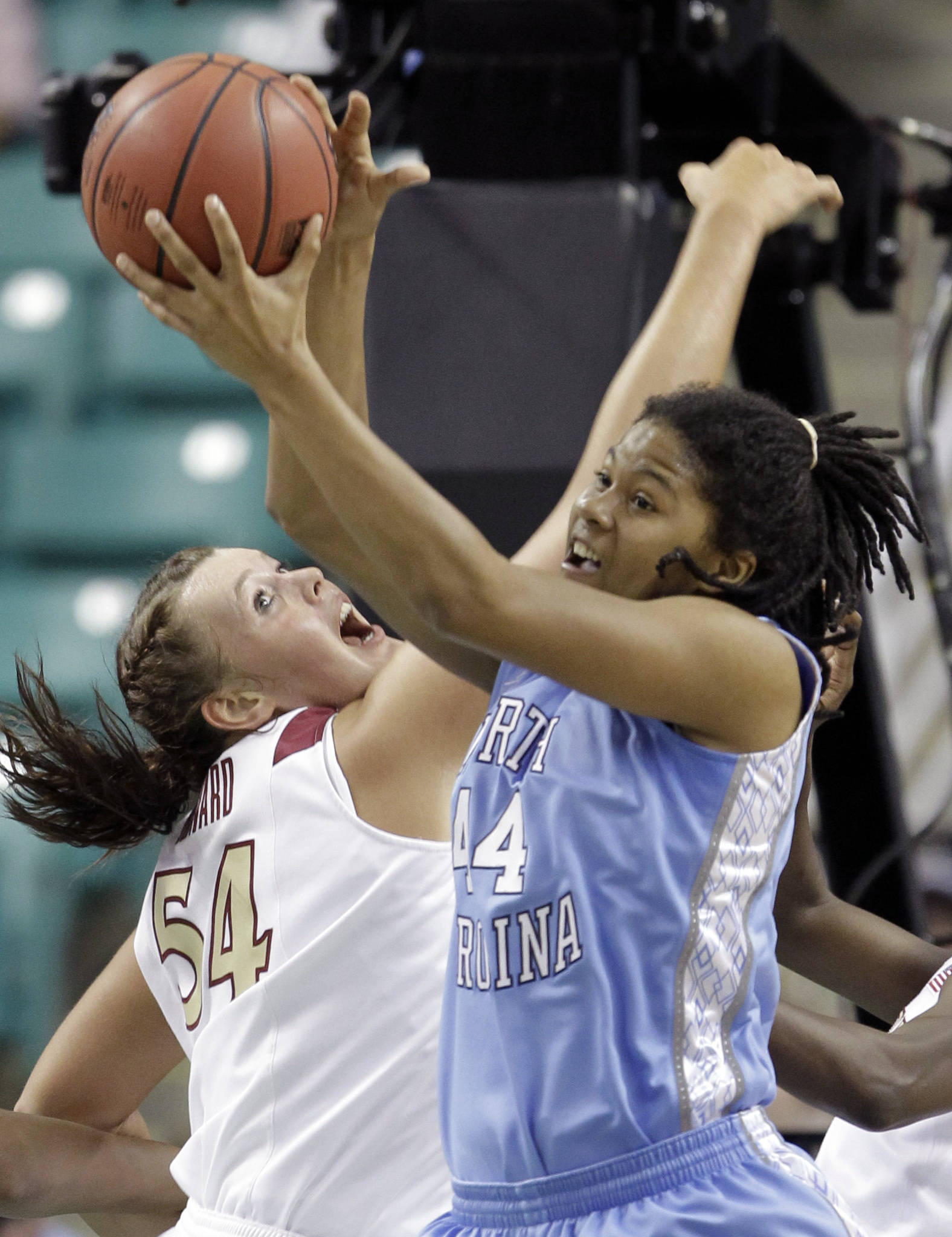 North Carolina's Tierra Ruffin-Pratt and Florida State's Cierra Bravard  battle for a rebound in the first half. (AP Photo/Chuck Burton)