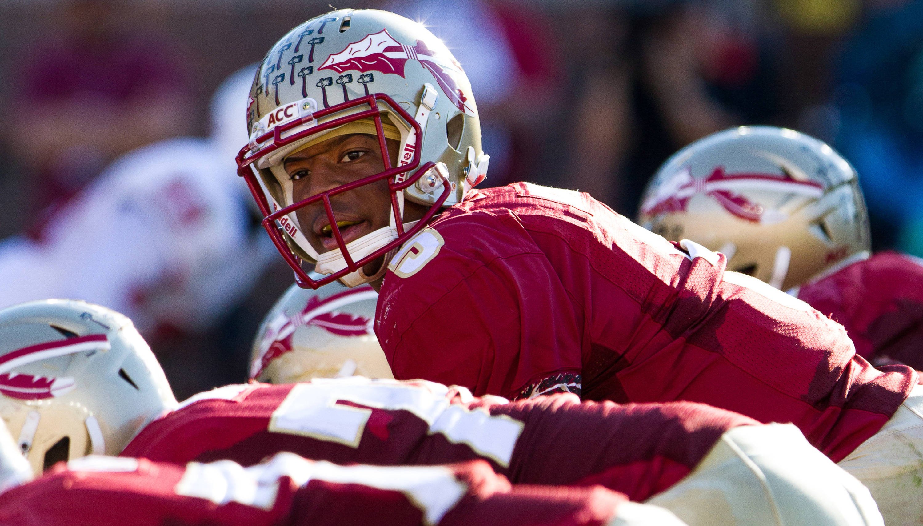 Jameis Winston (5) looks down his line during FSU Football's 49-17 win over NC State on Saturday, October 26, 2013 in Tallahassee, Fla. Photo by Michael Schwarz.