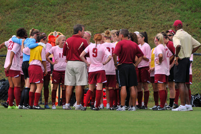 The Seminoles huddle before the start of Sunday's game against Miami.