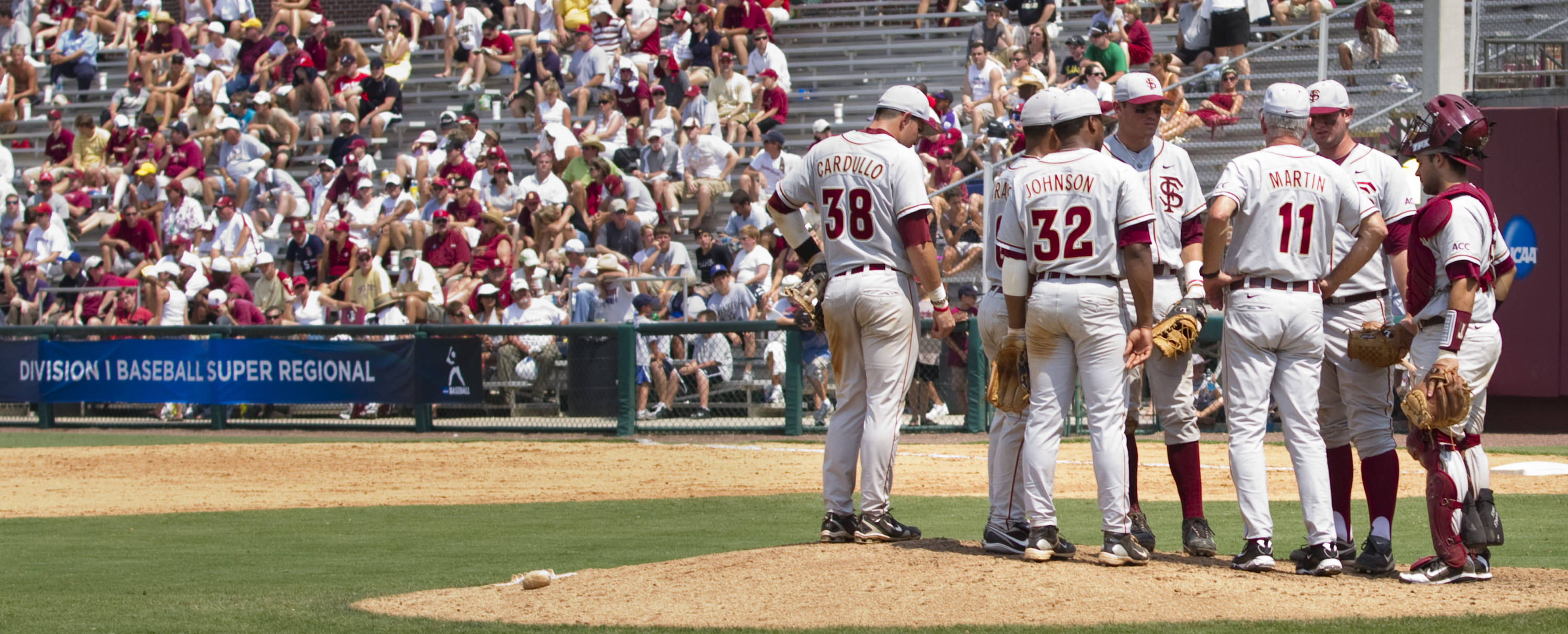 Mike Martin meets with Seminoles on the field during the second game against Vanderbilt.