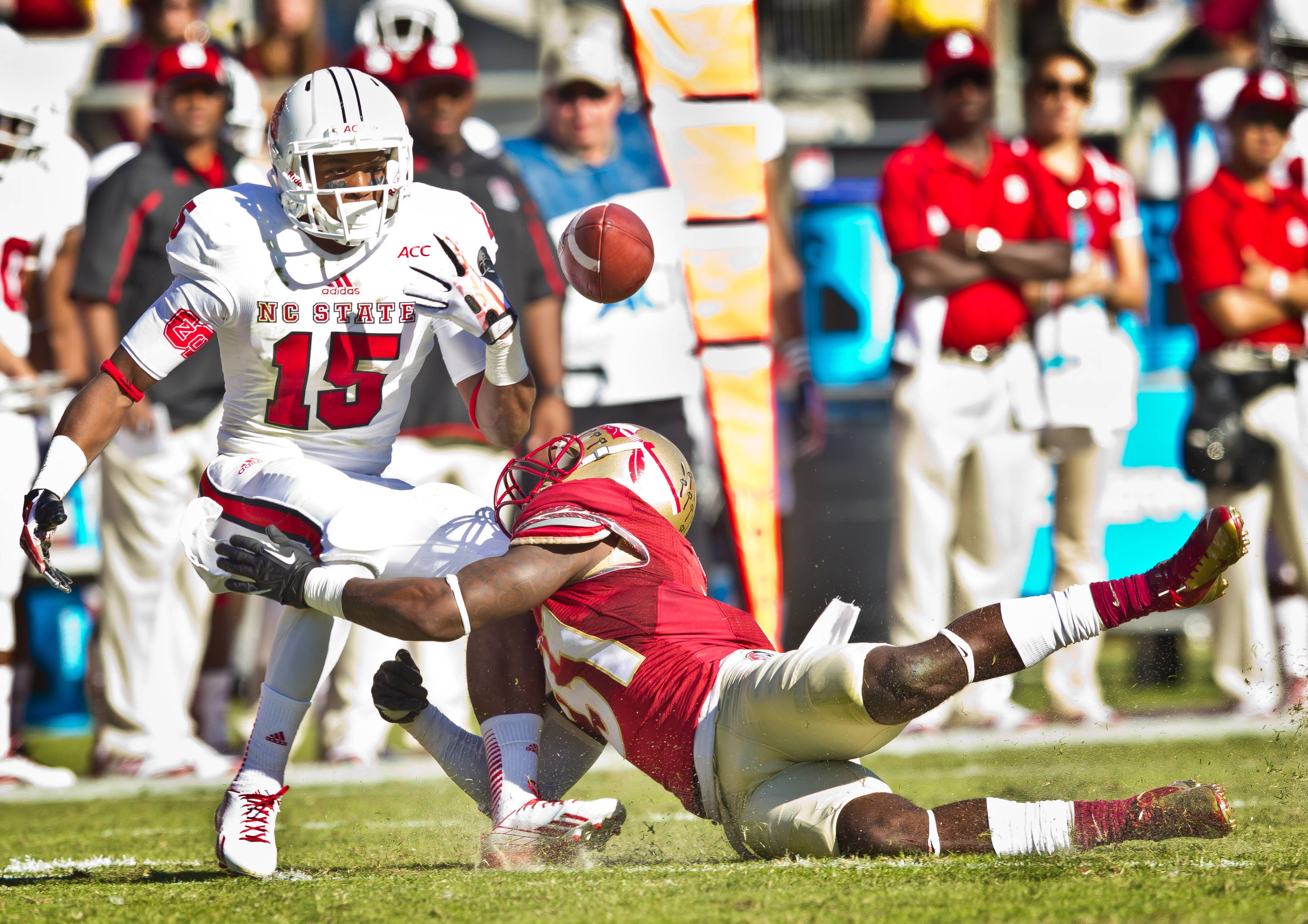 Terrence Brooks (31) forces an N.C. State fumble.