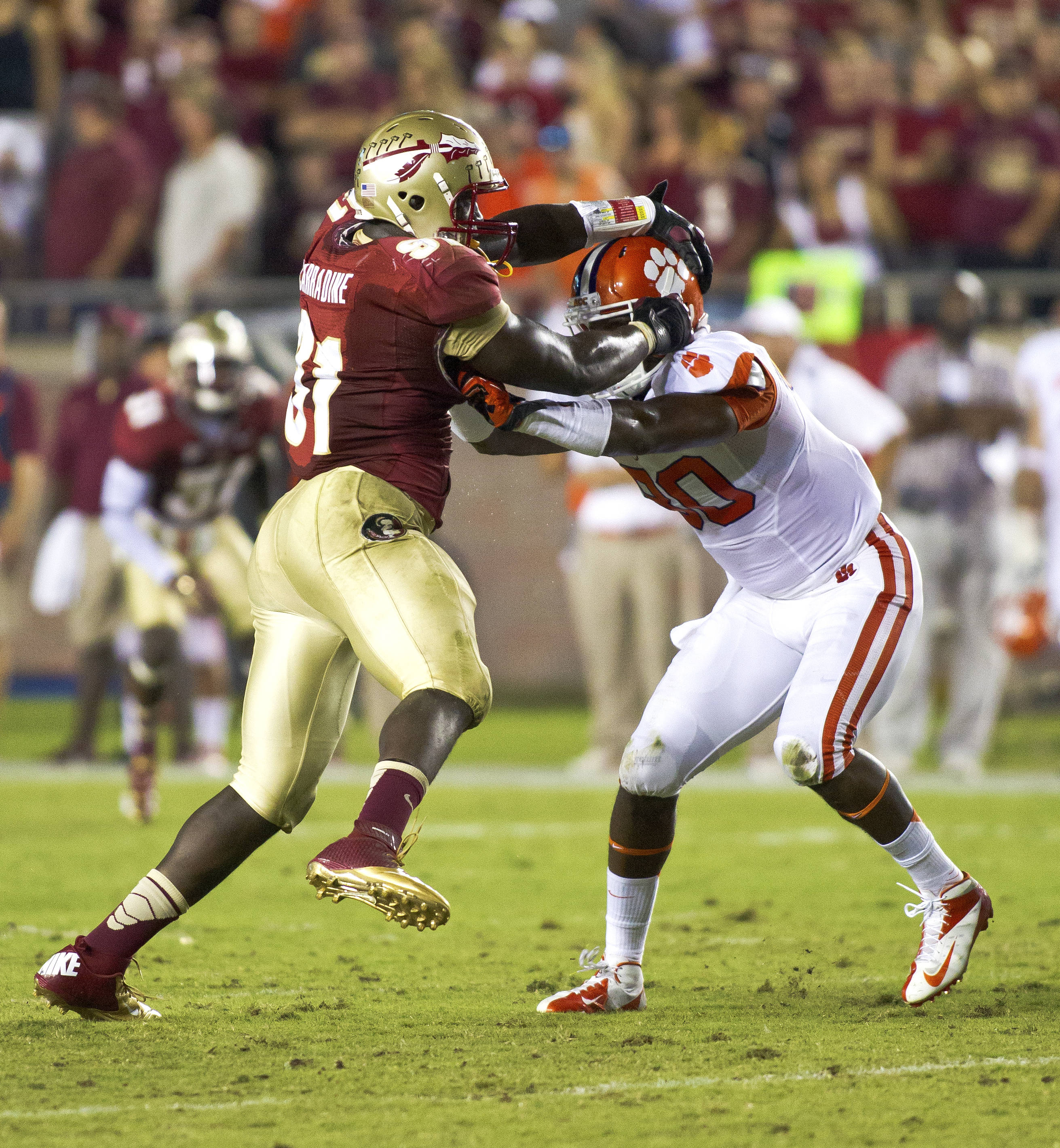 Cornellius Carradine (91) handling an offensive lineman, FSU vs Clemson, 9/22/12 (Photo by Steve Musco)