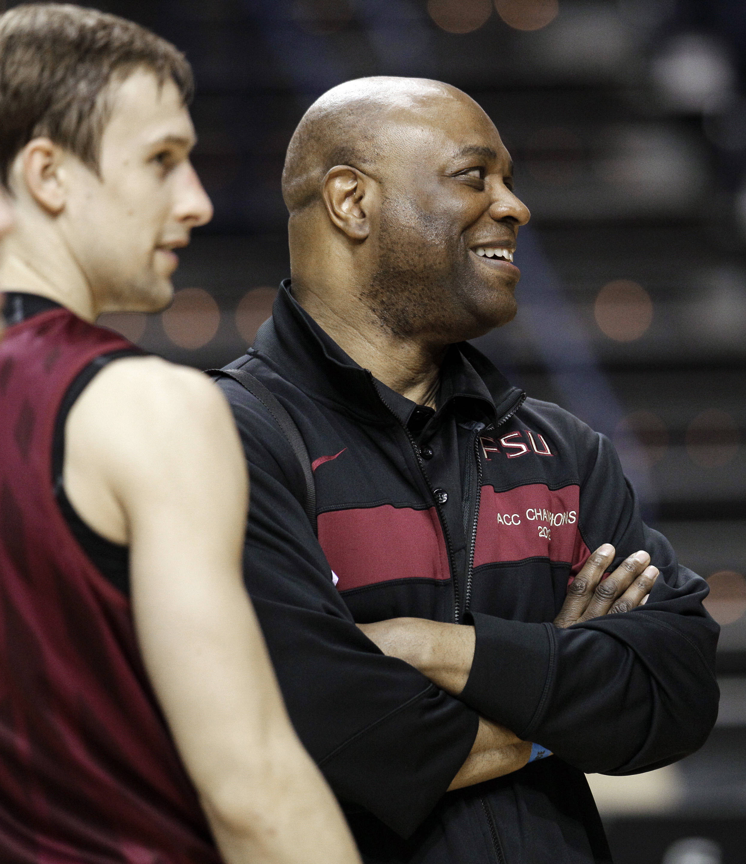 Florida State head coach Leonard Hamilton, right, watches his players alongside guard Deividas Dulkys during practice for an NCAA college basketball tournament game on Thursday, March 15, 2012, in Nashville, Tenn. Florida State is scheduled to play St. Bonaventure on Friday. (AP Photo/Mark Humphrey)