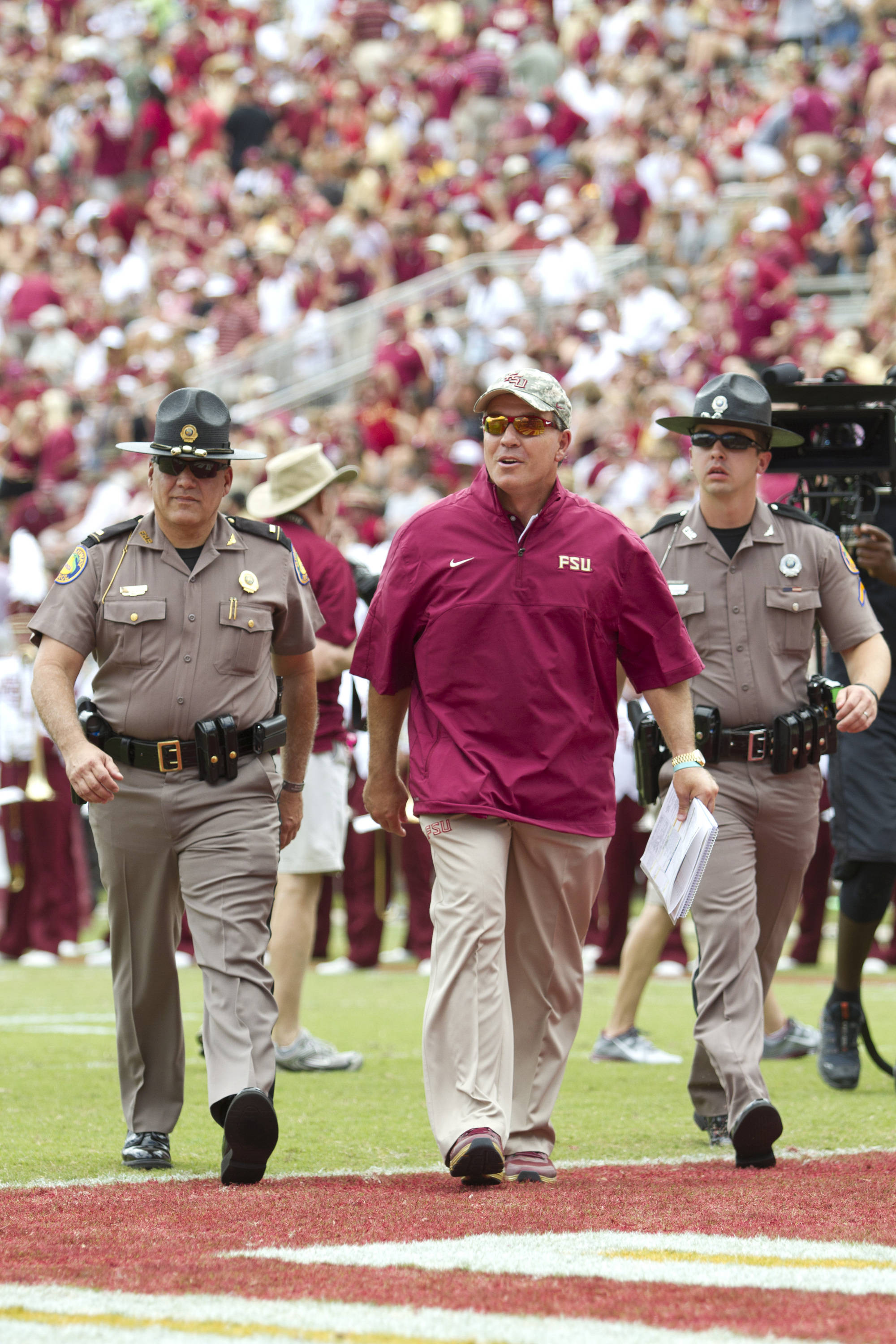 Jimbo Fisher walks off the field at halftime.