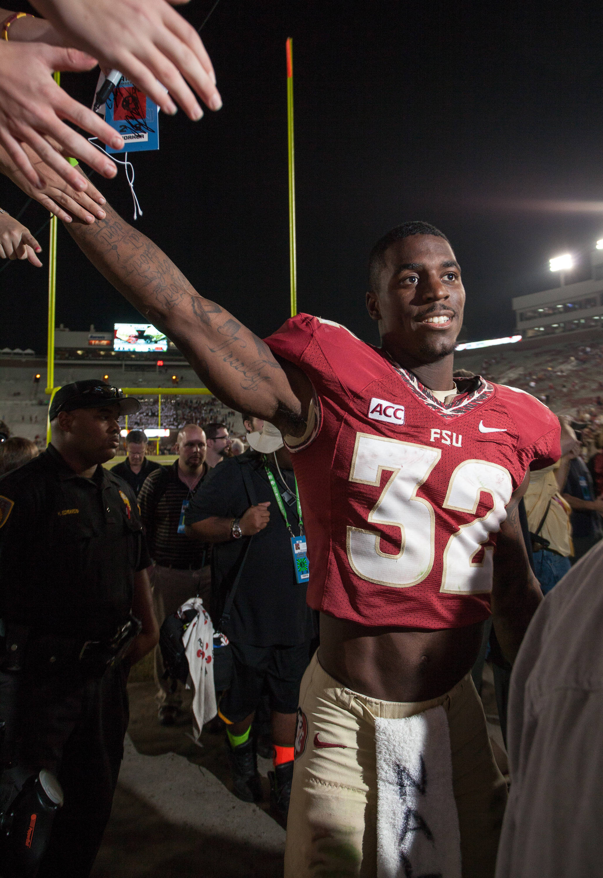 James Wilder, Jr. (32) high fives fans after FSU Football's 80-14 victory over Idaho in Tallahassee, Fla on Saturday, November 23, 2013. Photos by Mike Schwarz.