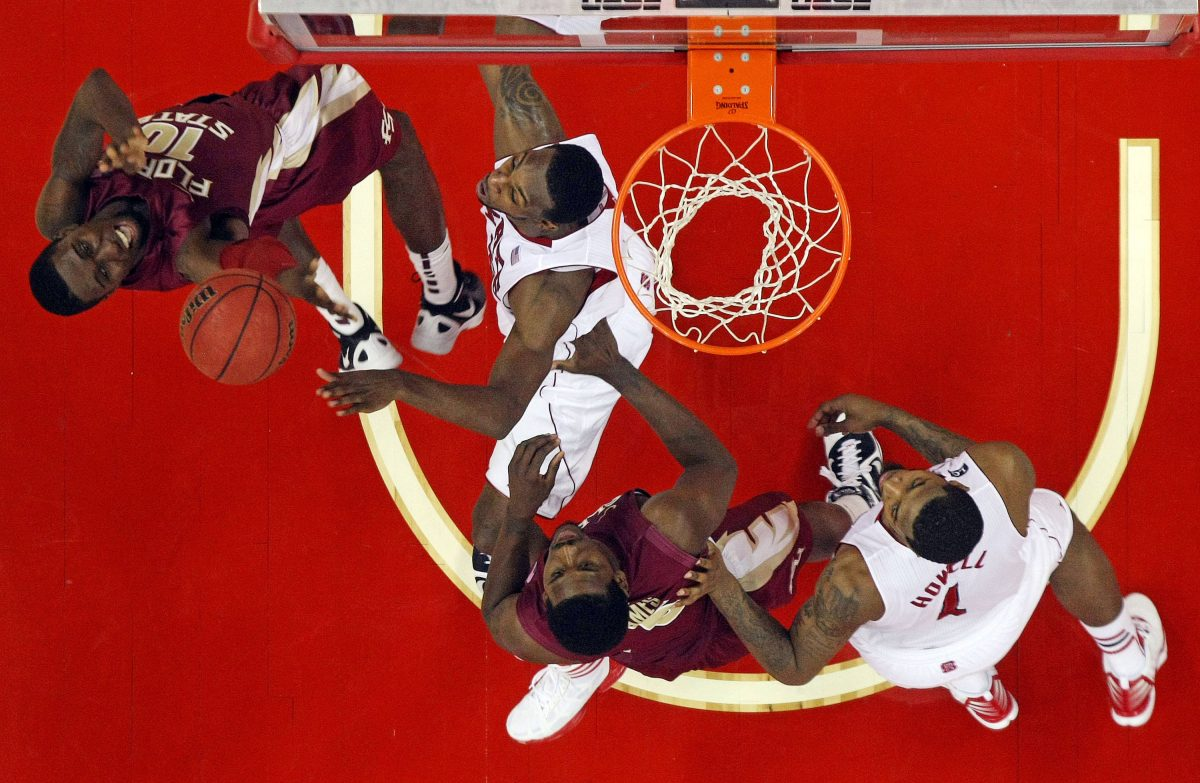 Florida State's Okaro White (10) tries to shoot the ball over North Carolina State's C.J. Leslie (5) with Seminoles Bernard James (5) and the Wolfpacks' Richard Howell (1) during the second half of an NCAA college basketball game in Raleigh, N.C., Saturday, Feb. 18, 2012. Florida State won 76-62. (AP Photo/Karl B DeBlaker)