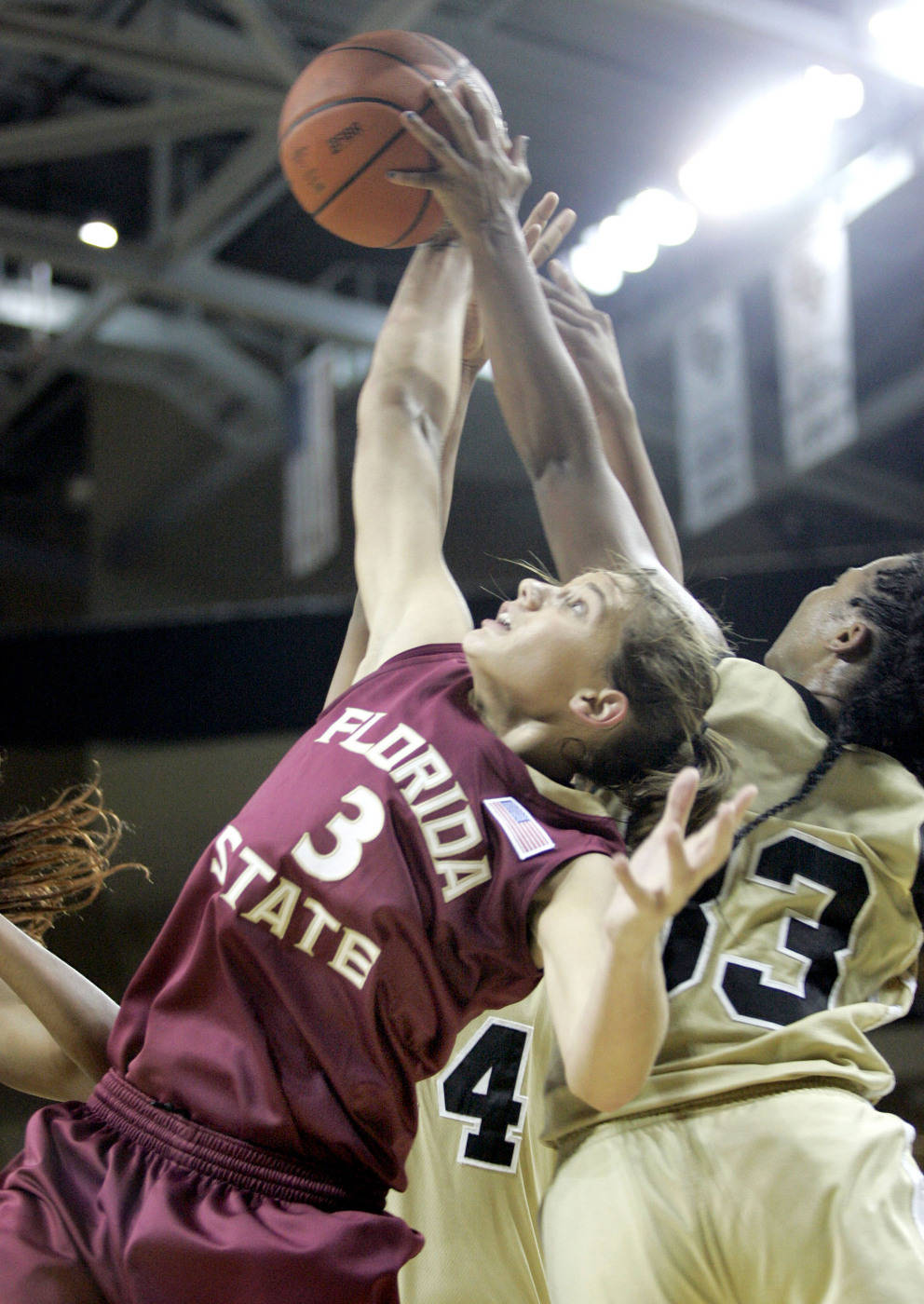 Central Florida guard Marshay White (33) fights for a rebound with Florida State guard Alexa Deluzio (3) during the first half. (Photo/Reinhold Matay)