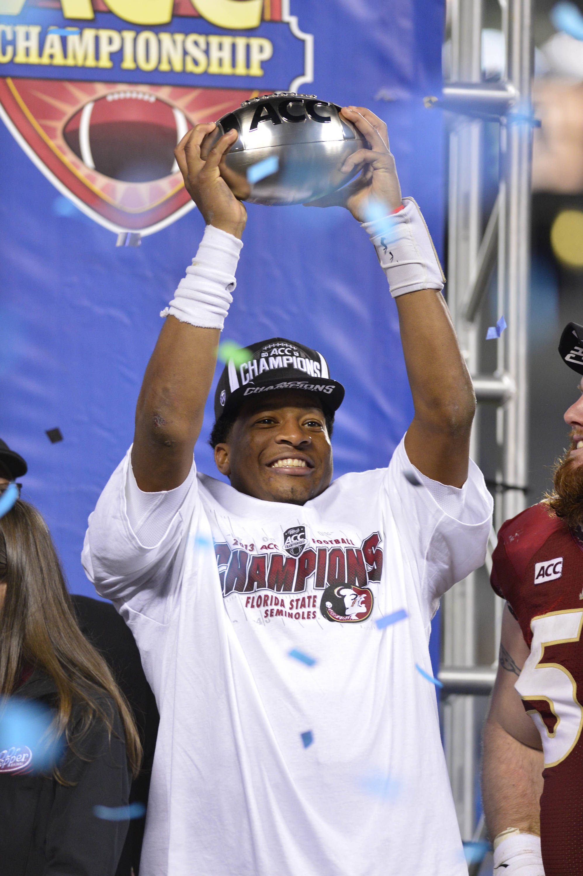 Dec 7, 2013; Charlotte, NC, USA; Florida State Seminoles quarterback Jameis Winston (5) holds up the ACC Championship trophy. The Seminoles defeated the Blue Devils 45-7 at Bank of America Stadium. Mandatory Credit: Bob Donnan-USA TODAY Sports