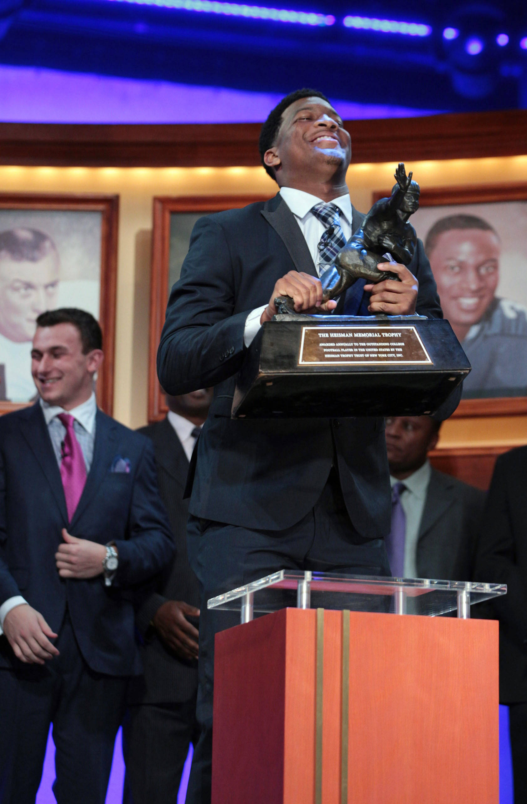 Dec 14, 2013; New York, NY, USA; Seminoles quarterback Jameis Winston reacts after being awarded the 2013 Heisman Trophy at the Best Buy Theatre in New York City. Kelly Kline/Heisman Trust/Handout Photo via USA TODAY Sports
