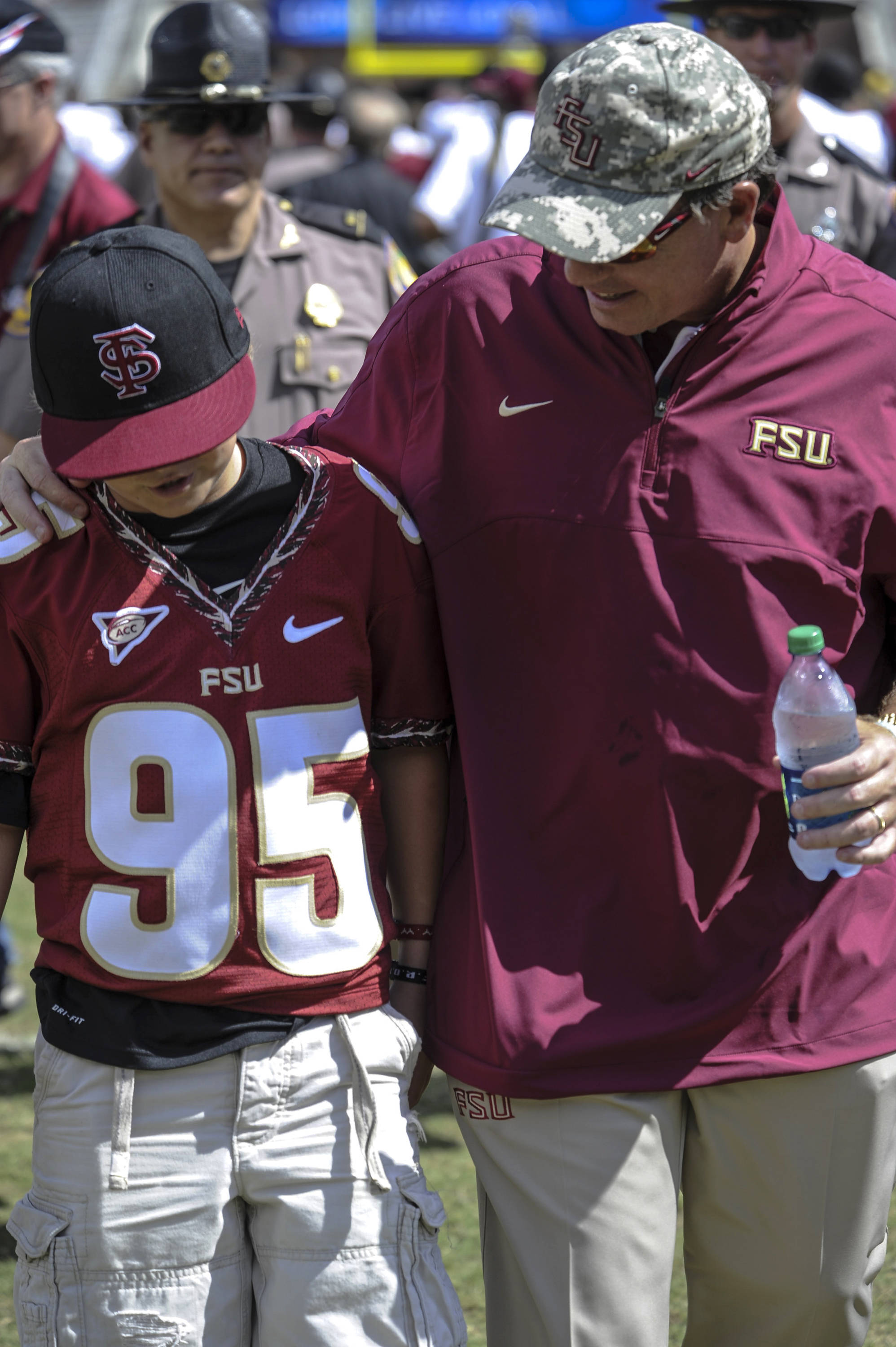 Jimbo Fisher leaves the filed with son Trey