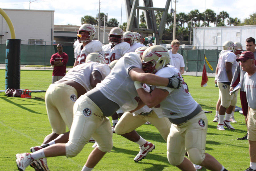 Offensive line works out during practice.