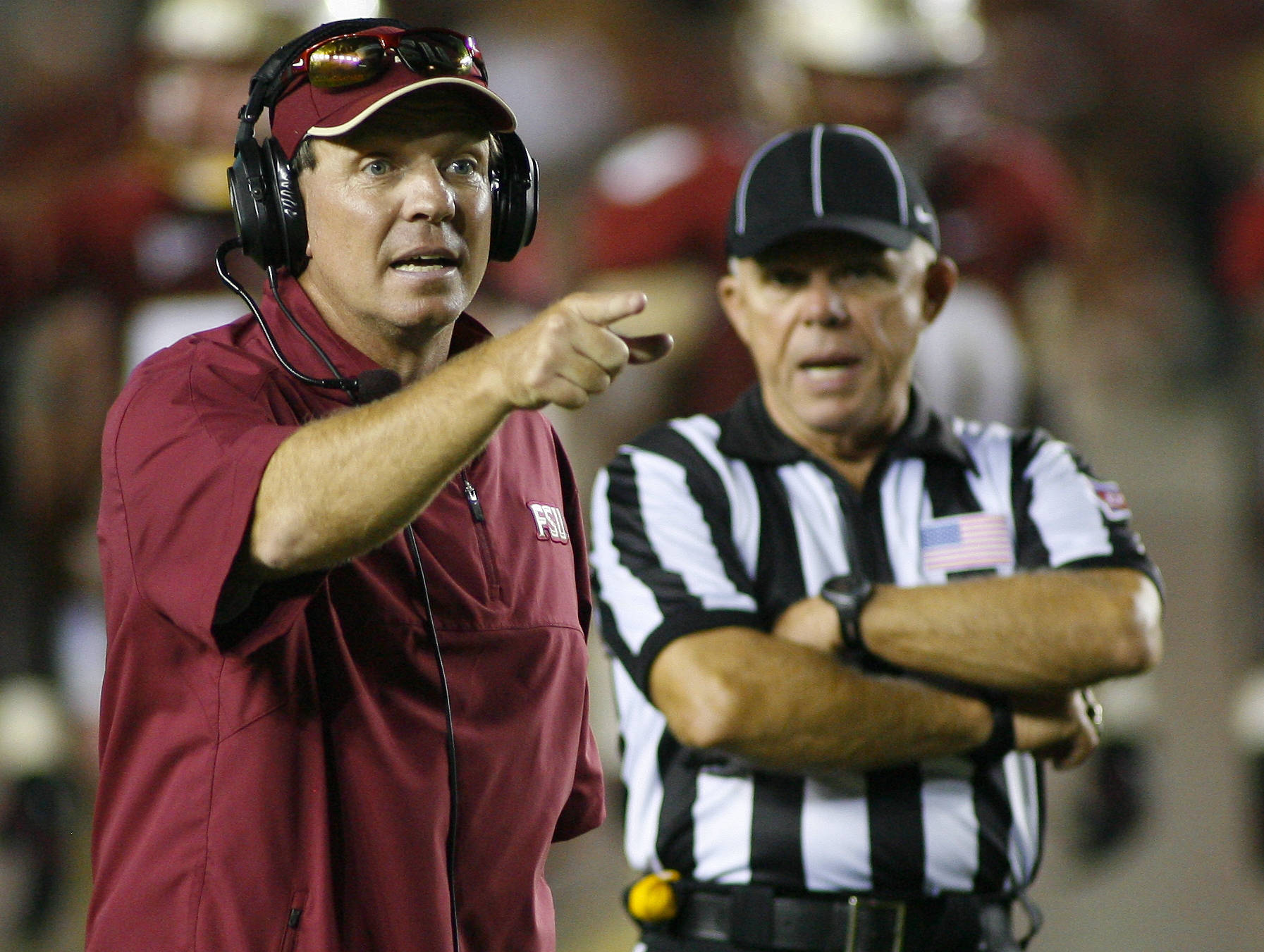 Florida State head coach Jimbo Fisher, left, talks to the referees during the fourth quarter. (AP Photo/Phil Sears)
