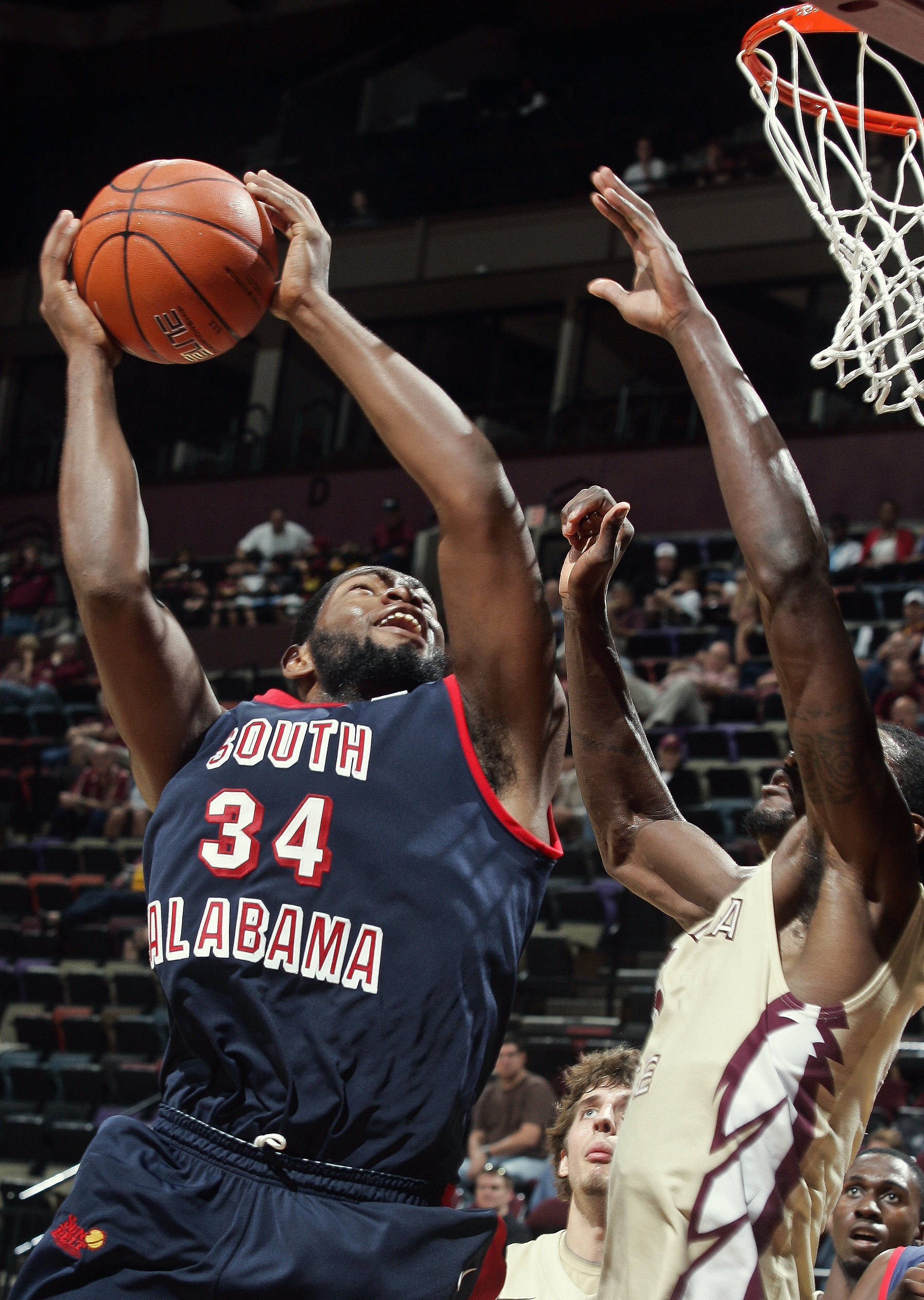 Florida State forward Bernard James, right, defends South Alabama forward Antoine Lundy. (AP Photo/Phil Sears)