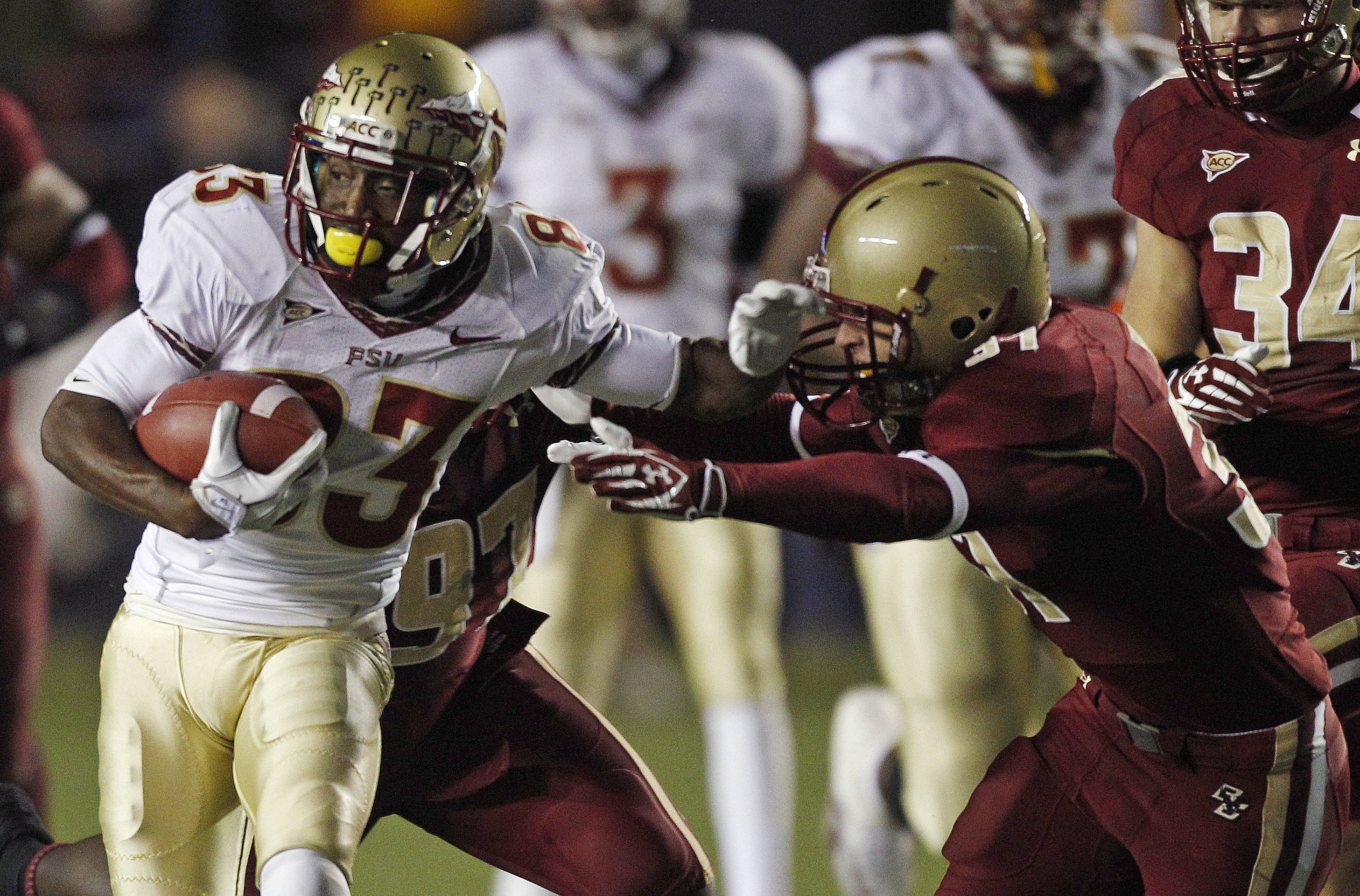 Florida State wide receiver Bert Reed, left, pushes off Boston College defensive back Hampton Hughes, right, during the first half. (AP Photo/Charles Krupa)