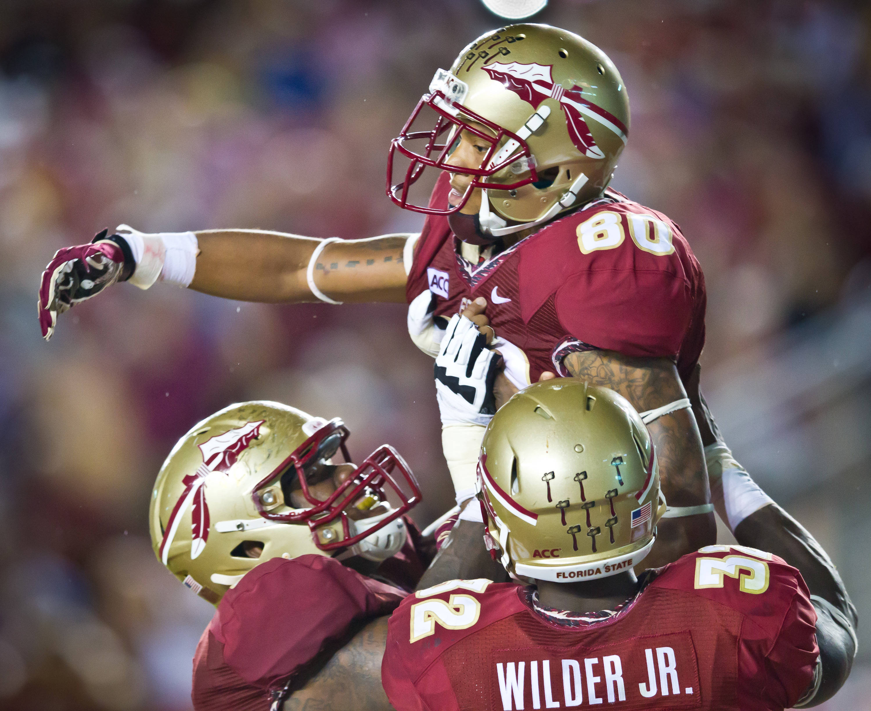 Rashad Greene (80) and teammates enjoy another FSU TD.