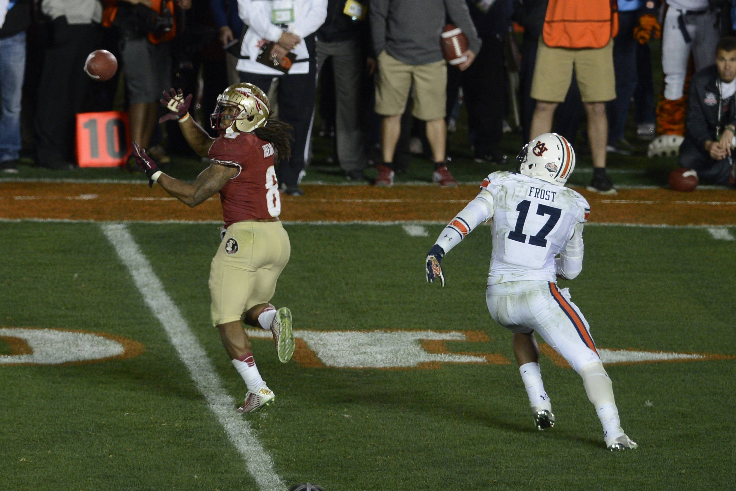Jan 6, 2014; Pasadena, CA, USA; Florida State Seminoles running back Devonta Freeman (8) catches a pass against Auburn Tigers linebacker Kris Frost (17) during the second half of the 2014 BCS National Championship game at the Rose Bowl.  Mandatory Credit: Kelvin Kuo-USA TODAY Sports