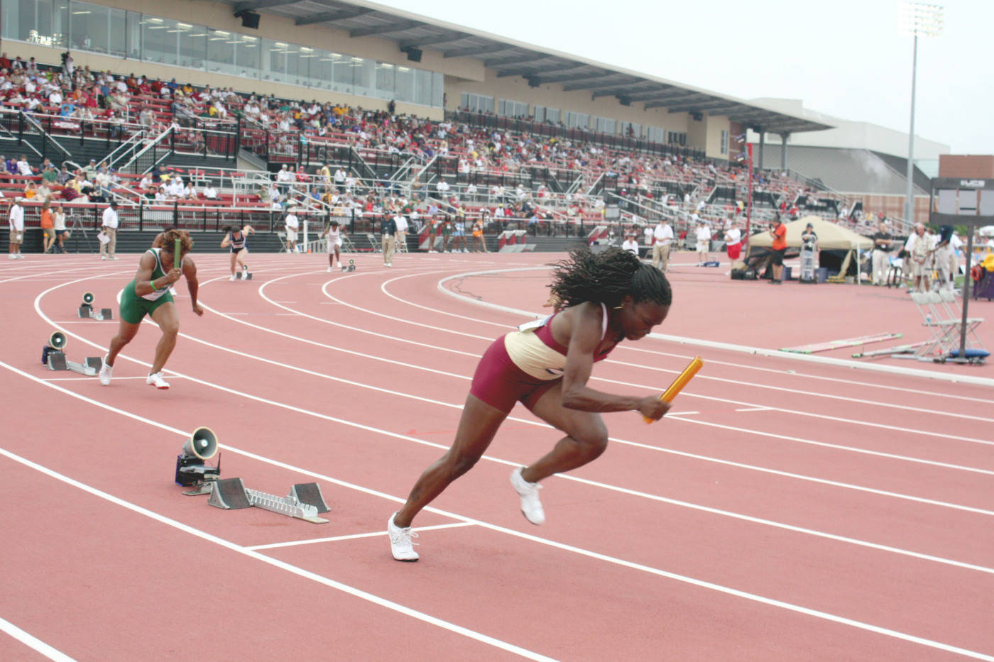 Nicole Marcus handles the first leg of the 4x100m relay for the Seminoles.