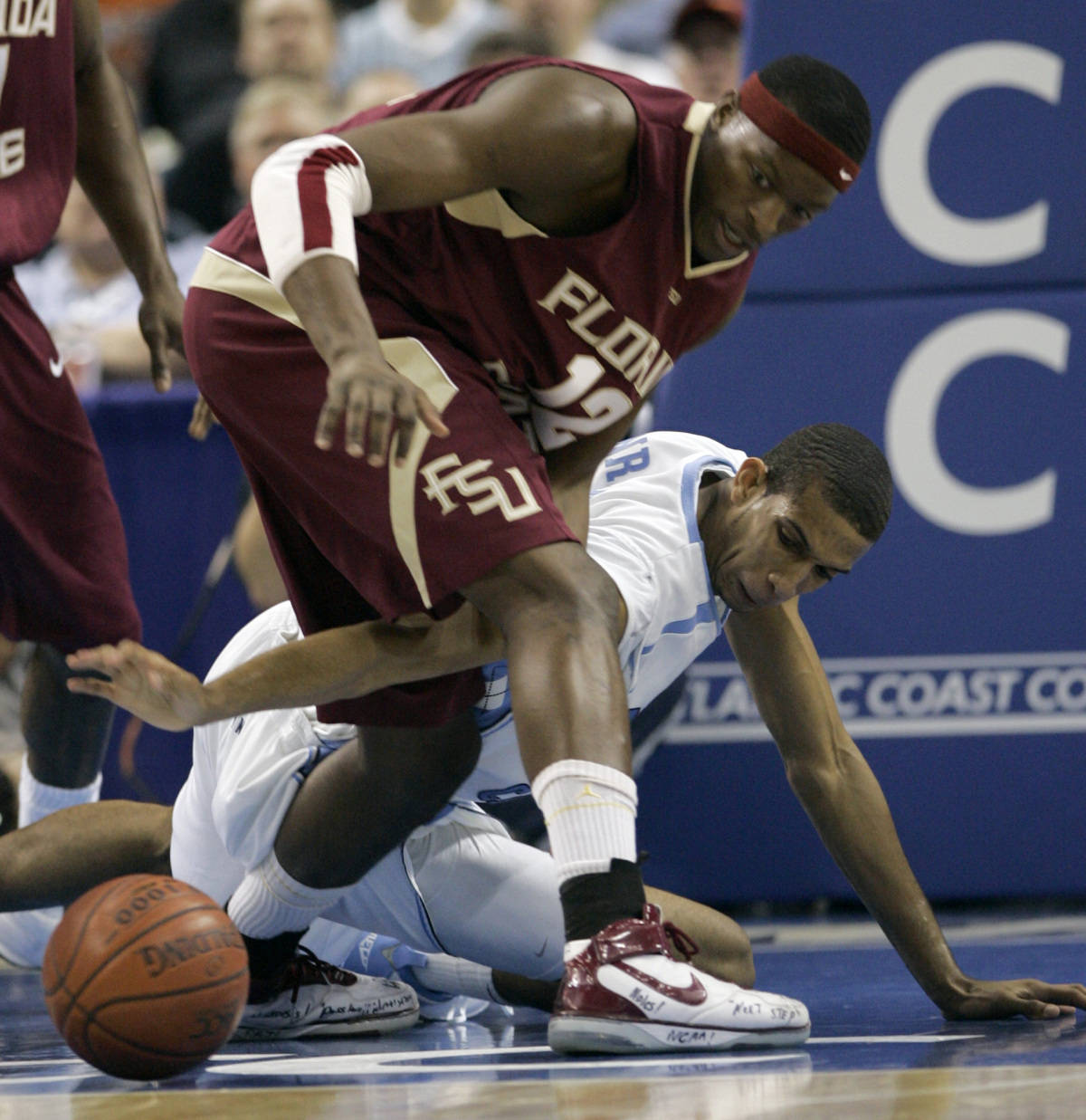 North Carolina's Brandan Wright, right, reaches for a loose ball between the legs of Florida State's Al Thornton (12) during a second round game of the Men's Atlantic Coast Conference basketball tournament in Tampa, Fla., Friday, March 9, 2007. (AP Photo/John Raoux)