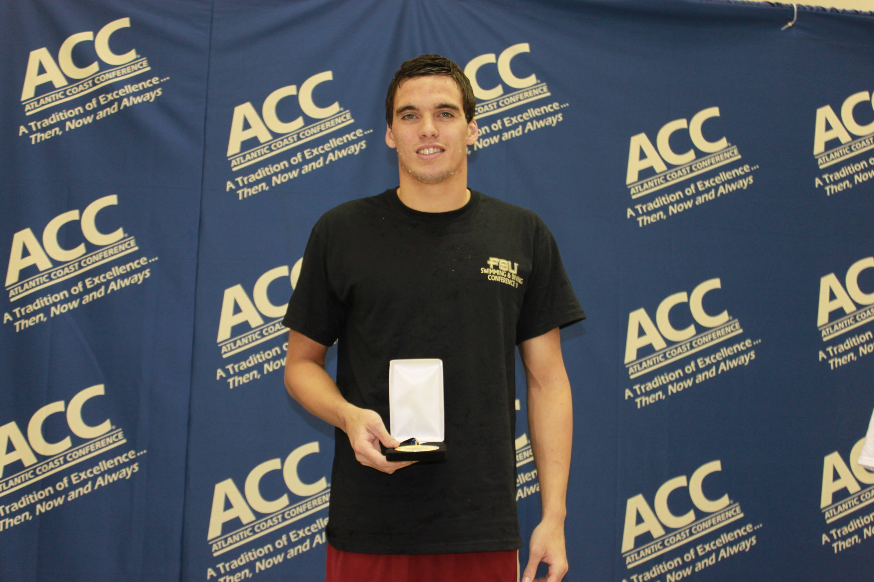 Rob Holderness with his gold medal in the 200 breast
