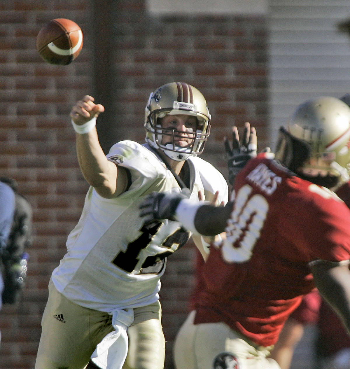 Western Michigan quarterback Ryan Cubit, left, throws a second-quarter pass during a college football game against Florida State, Saturday, Nov. 18, 2006, in Tallahassee, Fla. (AP Photo/Phil Coale)