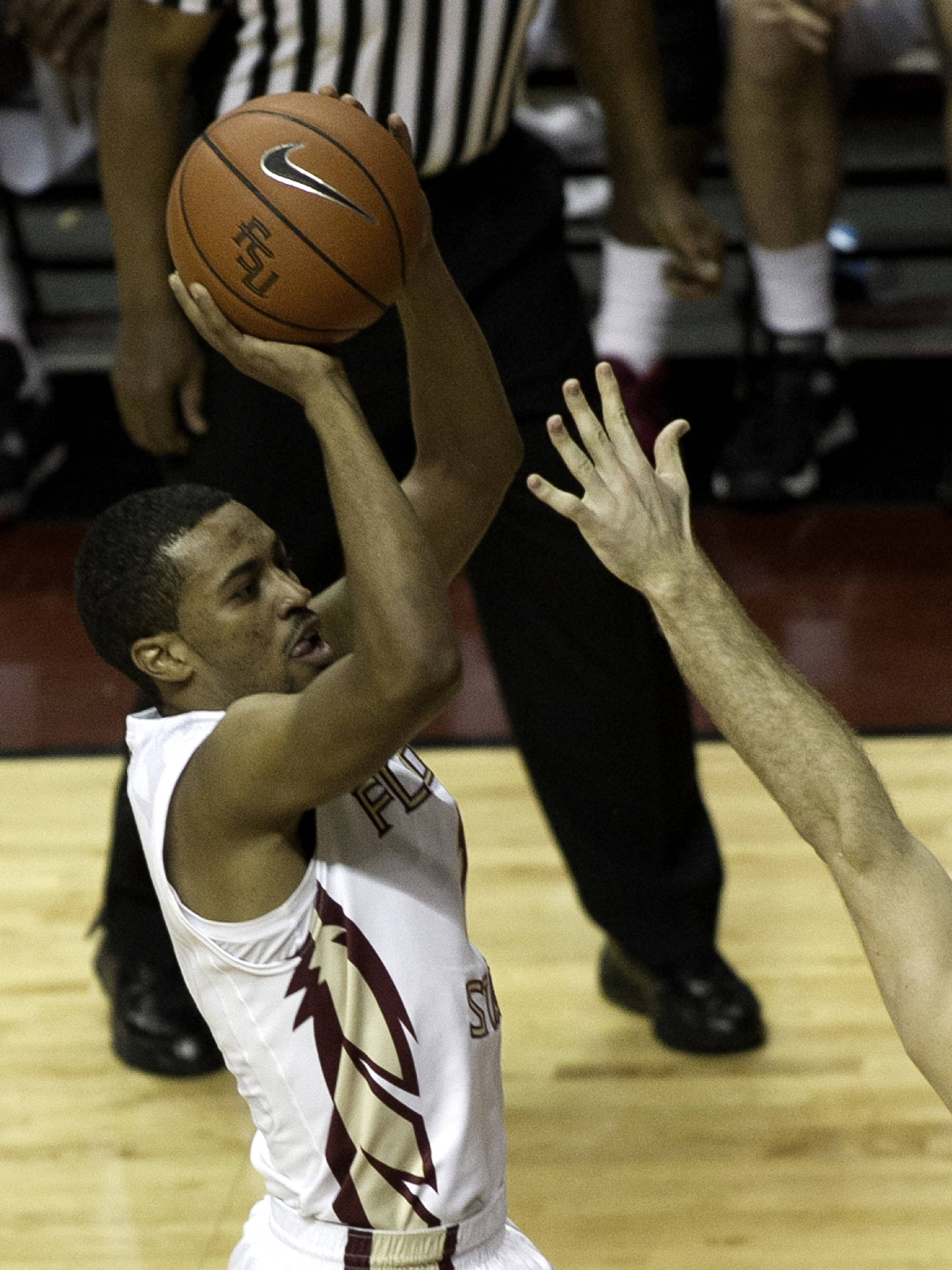 Devon Bookert (1) with a three, FSU vs Notre Dame, 1-21-14, (Photo's by Steve Musco)