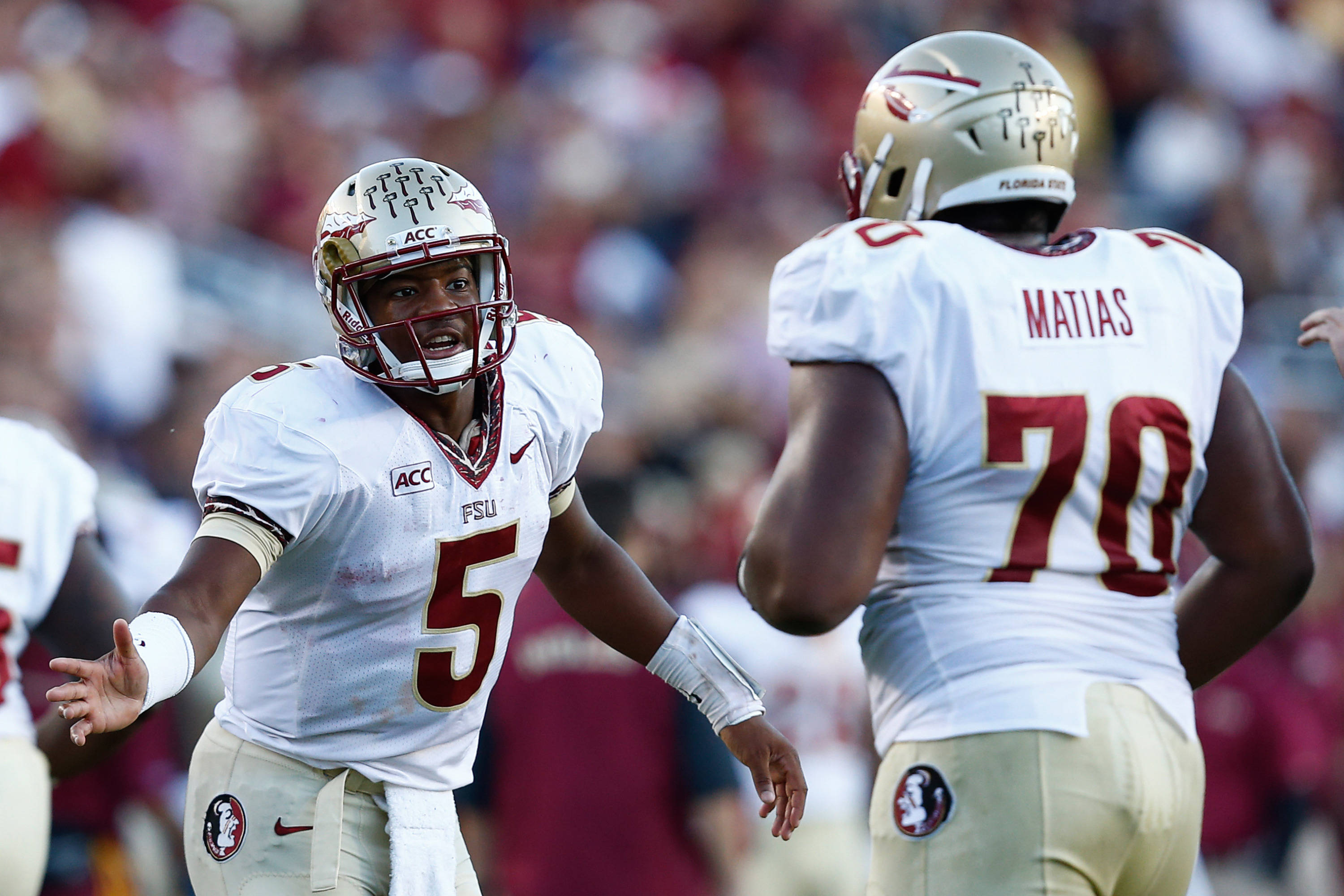 Jameis Winston (5) and Josue Matias (70) celebrate. Mandatory Credit: Mark L. Baer-USA TODAY Sports