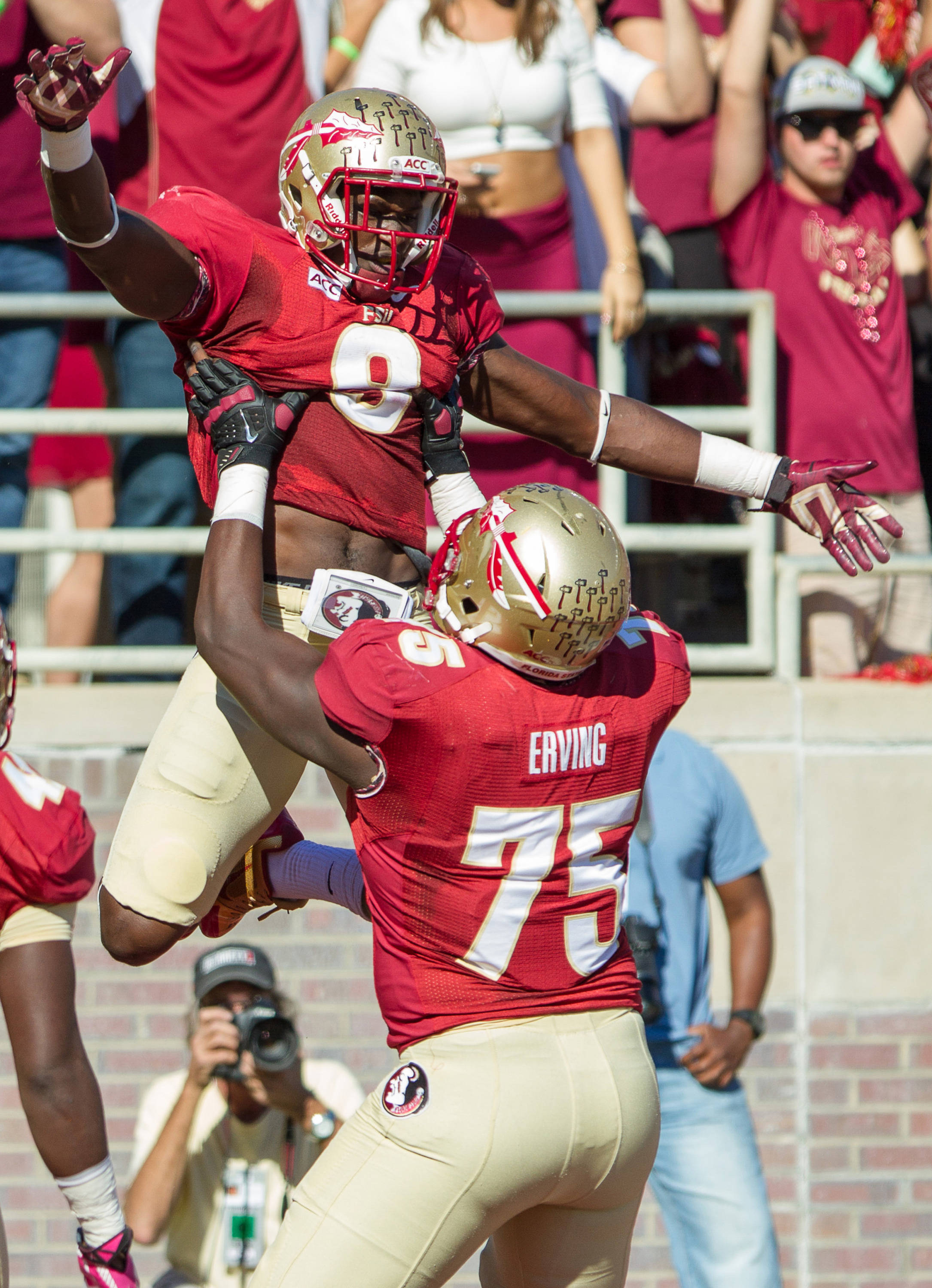 Karlos Williams (9) celebrates after scoring a touchdown during FSU Football's 49-17 win over NC State on Saturday, October 26, 2013 in Tallahassee, Fla. Photo by Michael Schwarz.