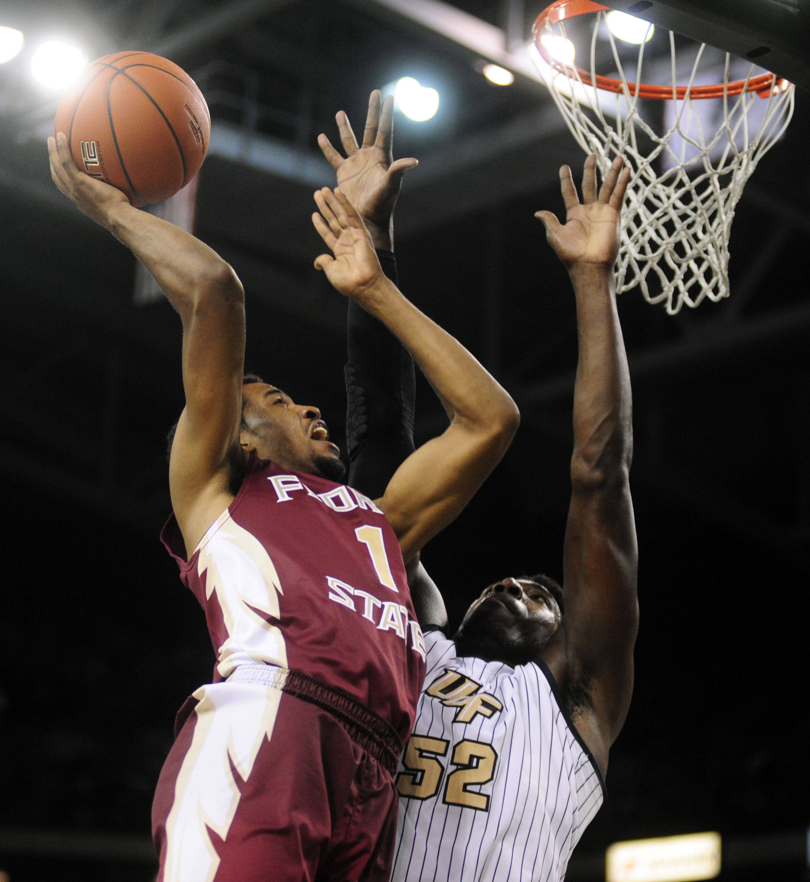 Guard Devon Bookert (1) goes for a layup in front of Knights forward Staphon Blair (52). David Manning-USA TODAY Sports