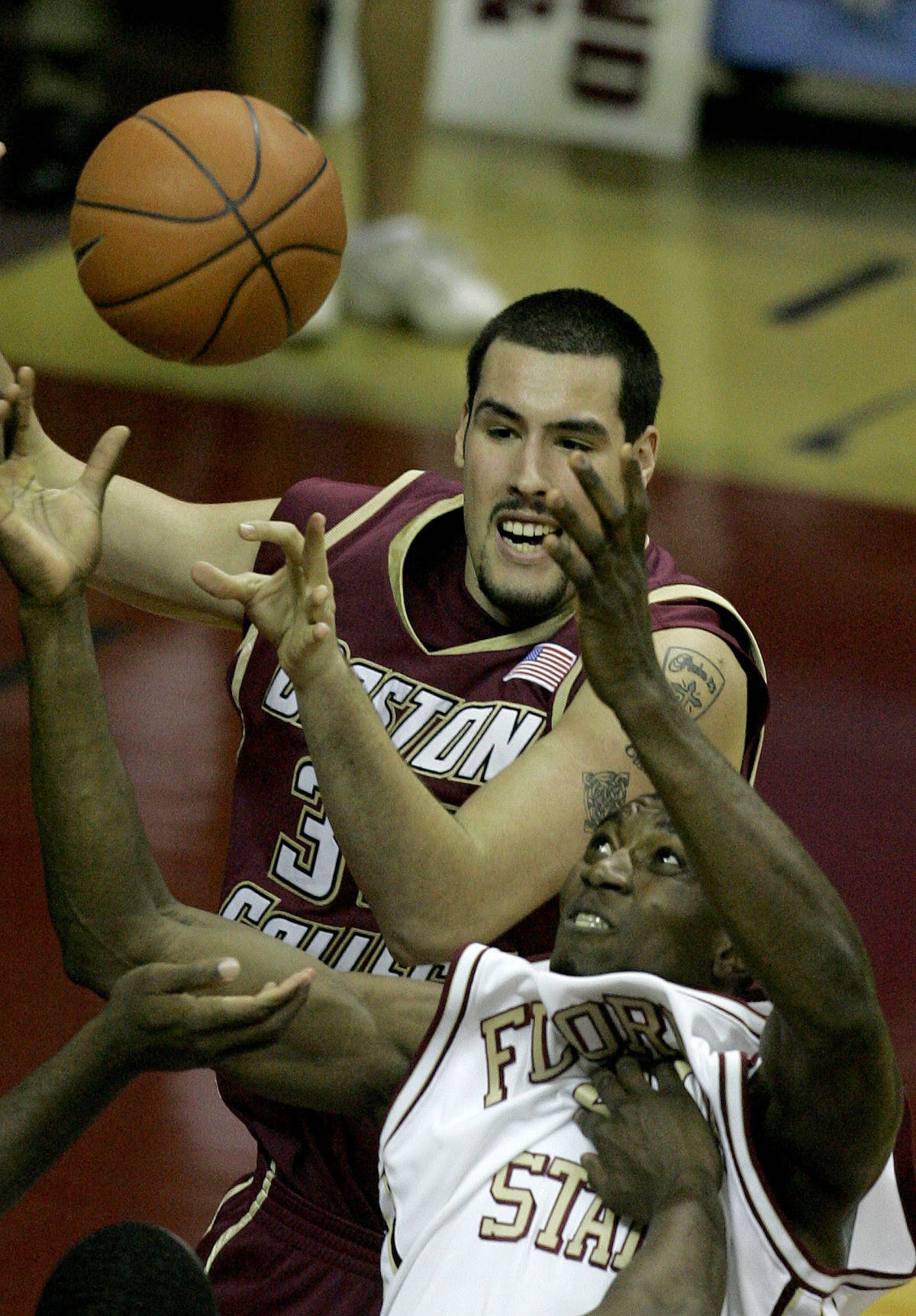 Boston College's John Oates, top, fouls Florida State's Uche Echefu while battling for a second-half rebound during a college basketball game, Sunday, Feb. 11, 2007, in Tallahassee, Fla.(AP Photo/Phil Coale)