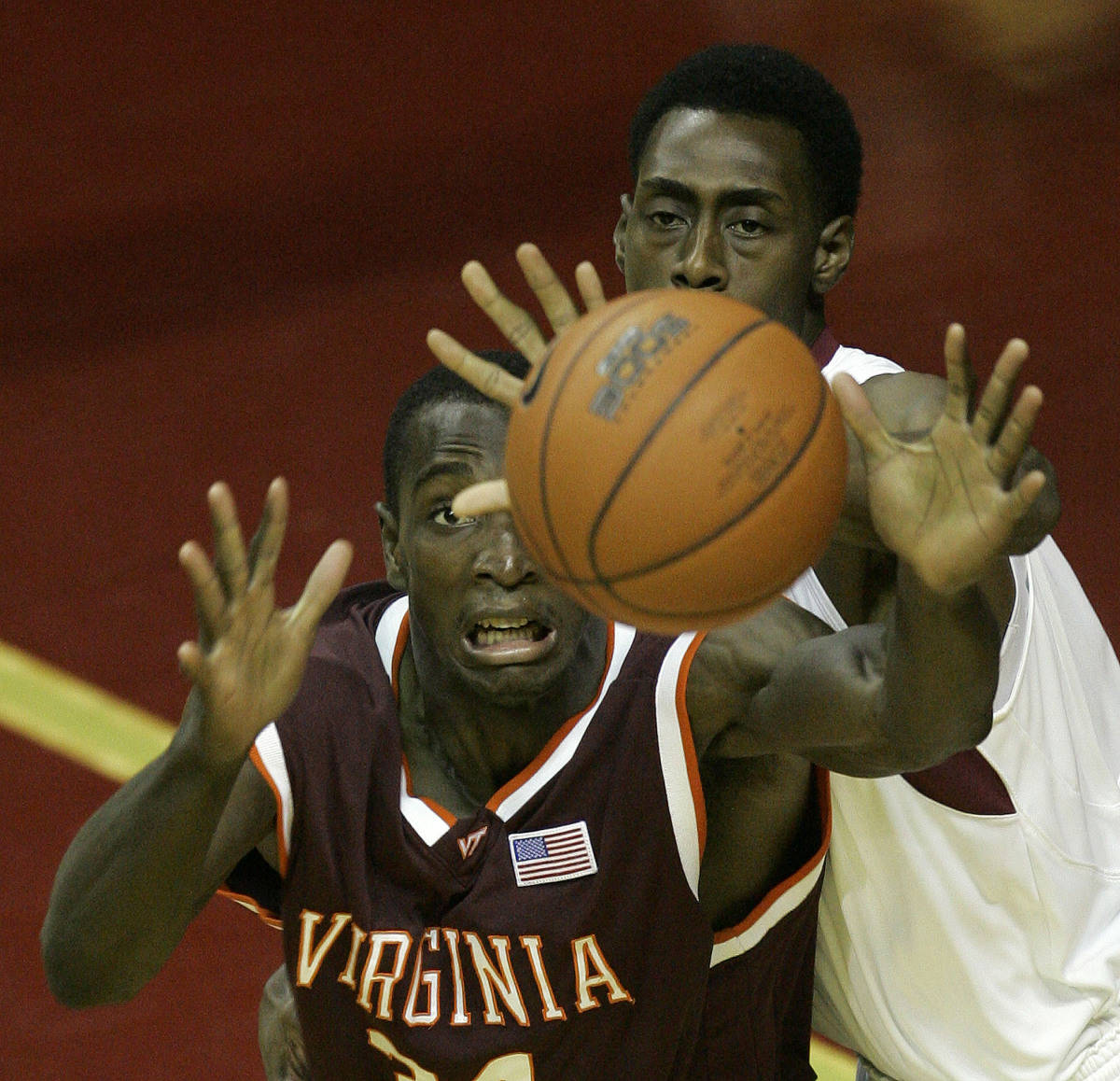 Virginia Tech's Cheick Diakite, left, and Florida State's Casaan Breeden, right, go for the ball during the first half of a college basketball game, Wednesday, Jan. 17, 2007, in Tallahassee, Fla.(AP Photo/Phil Coale)