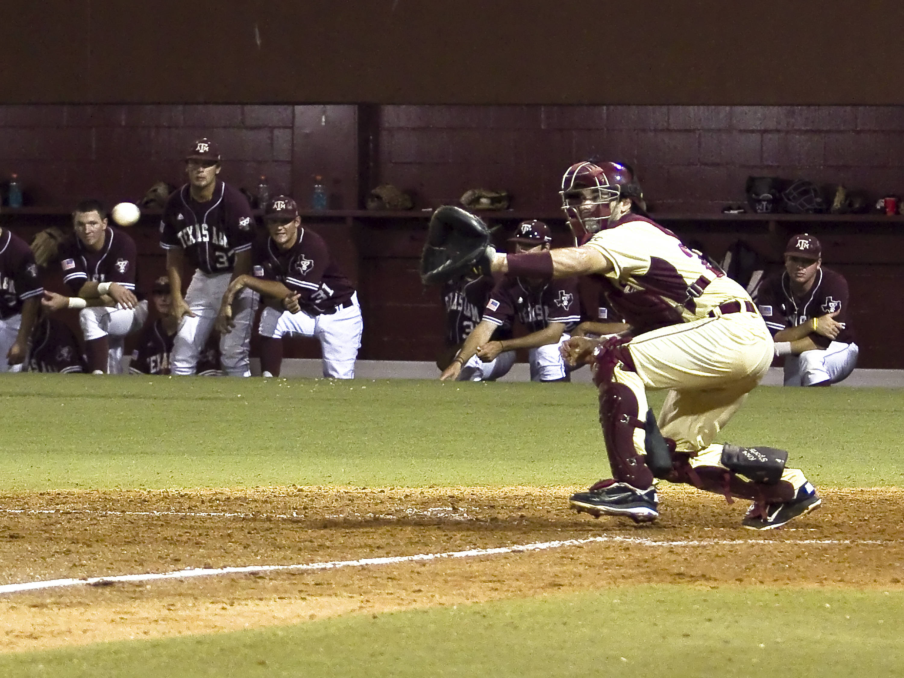 Catcher Rafael Lopez (29) about to receive a throw from Sherman Johnson to record a force-out at home.