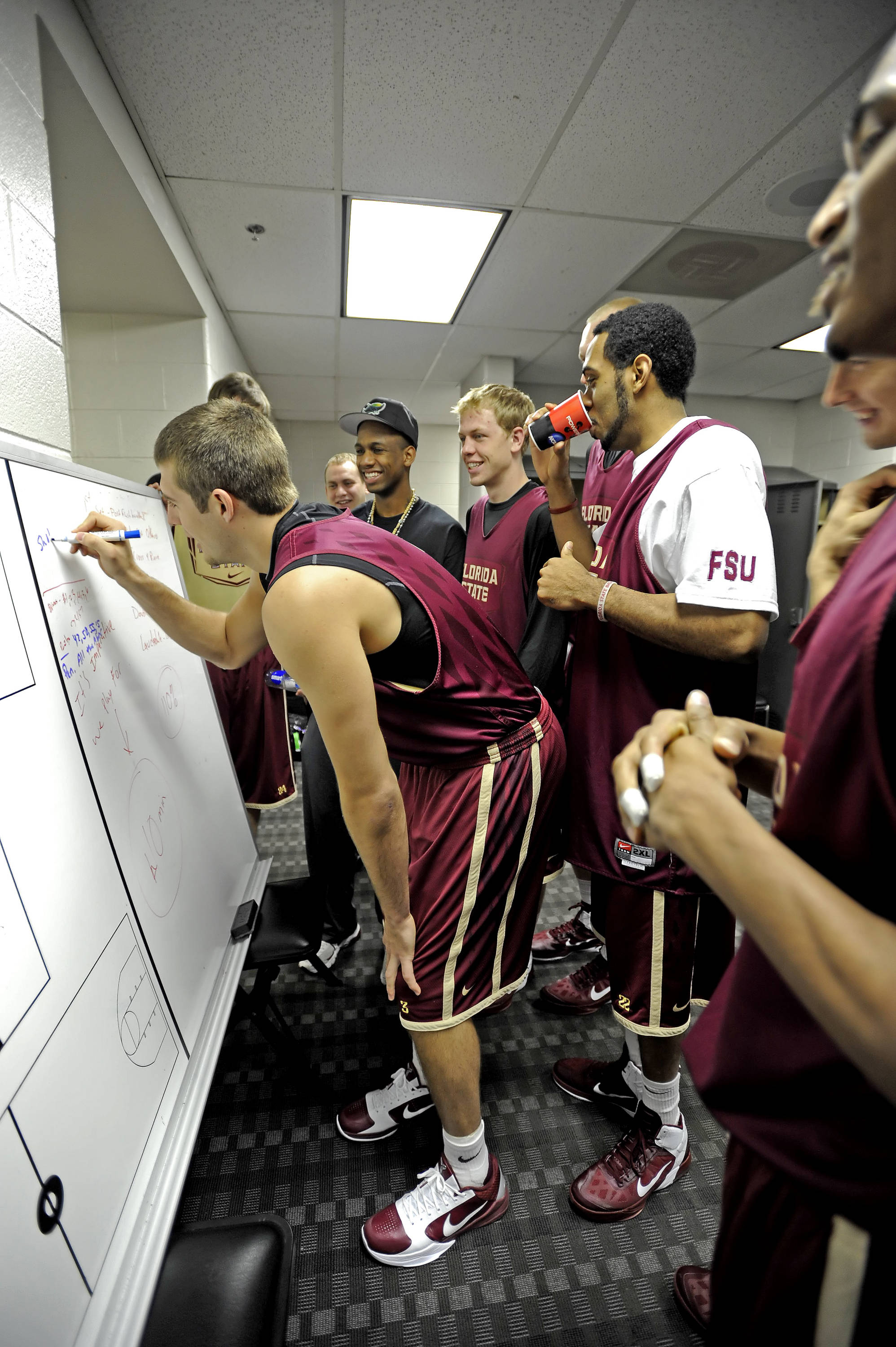 Players write on the white board in the locker room