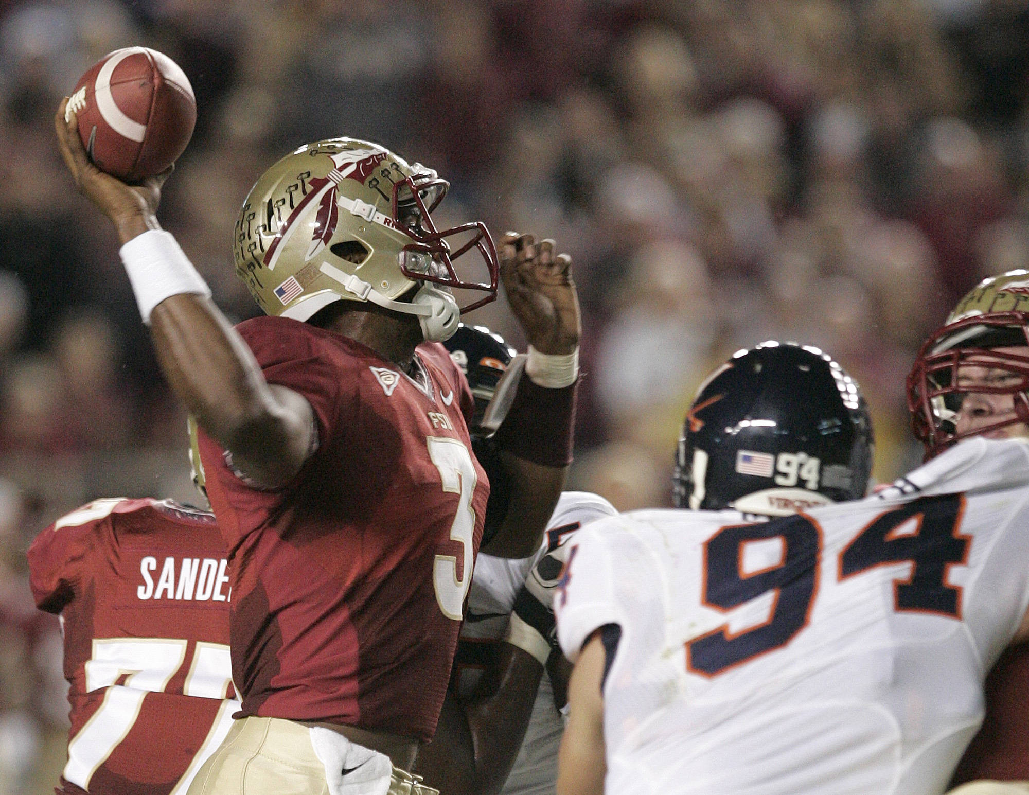 Florida State's EJ Mauel (3) is pressured by Virginia's Matt Conrath while attempting a pass.(AP Photo/Steve Cannon)