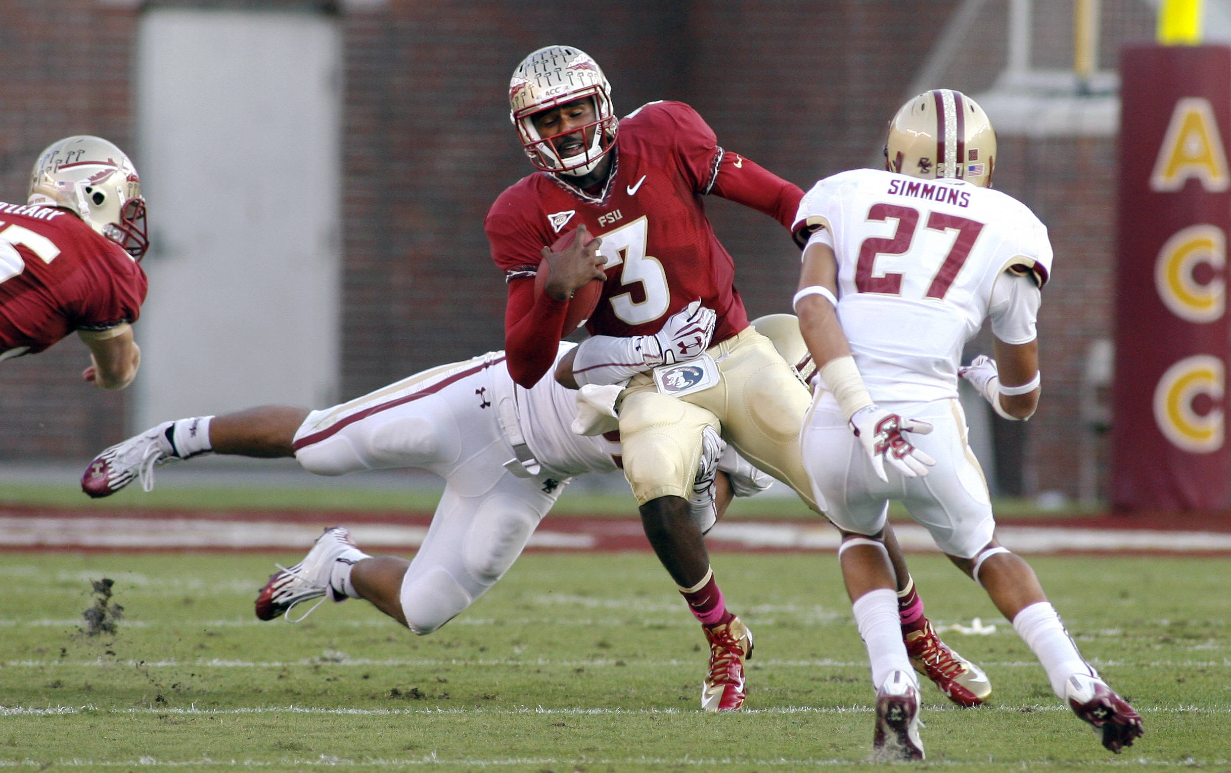 Florida State quarterback E.J. Manuel (3) is caught in the backfield by Boston College defensive end Kasim Edebali (in back) during the first quarter. (AP Photo/Phil Sears)