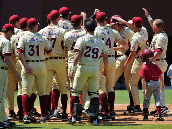 The Seminoles celebrate Jack Posey's solo home run on Sunday.
