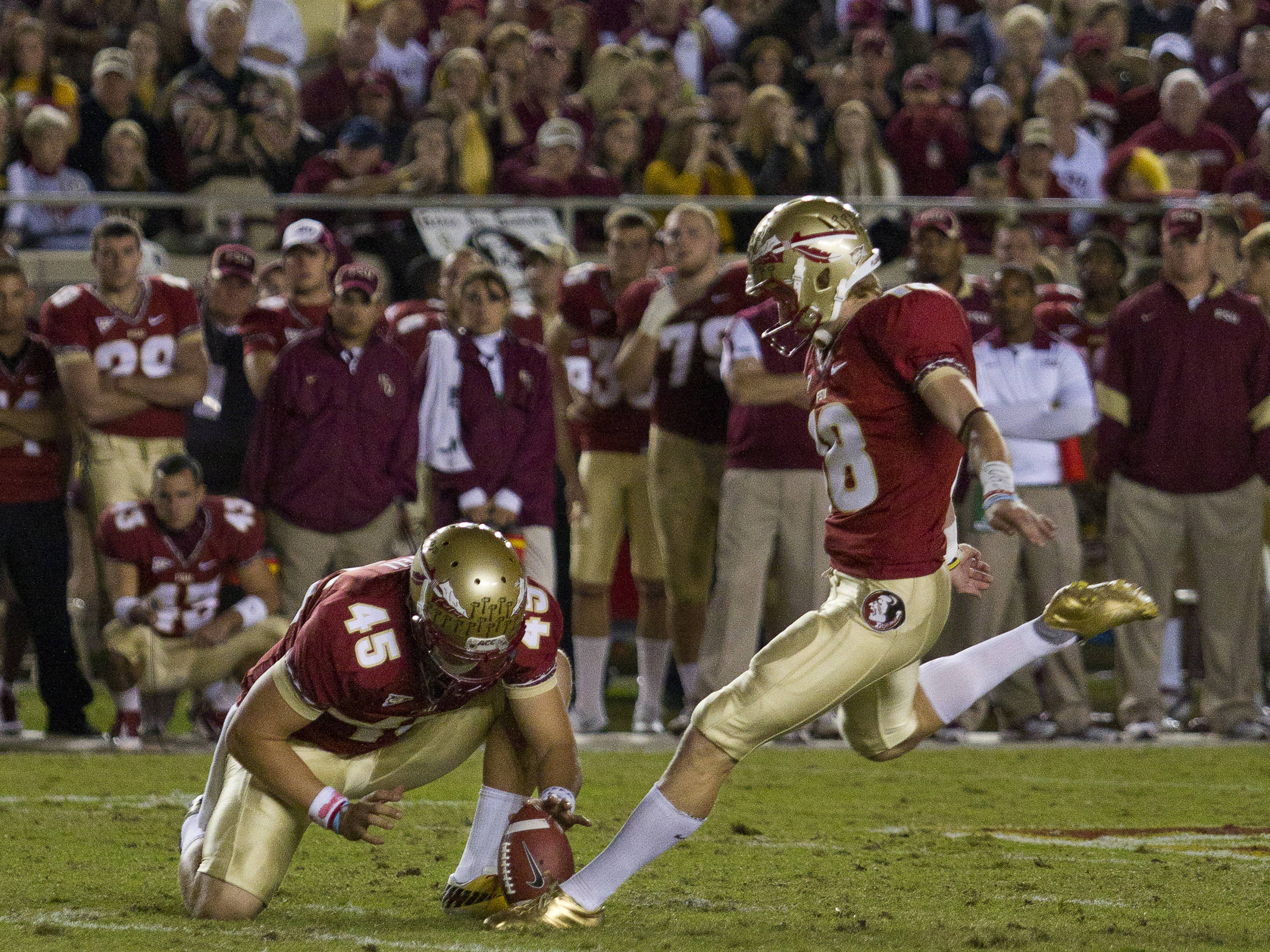 Dustin Hopkins (18) makes a 26 yard field goal with 54 seconds left before half-time of the game against Virginia on November 19, 2011.