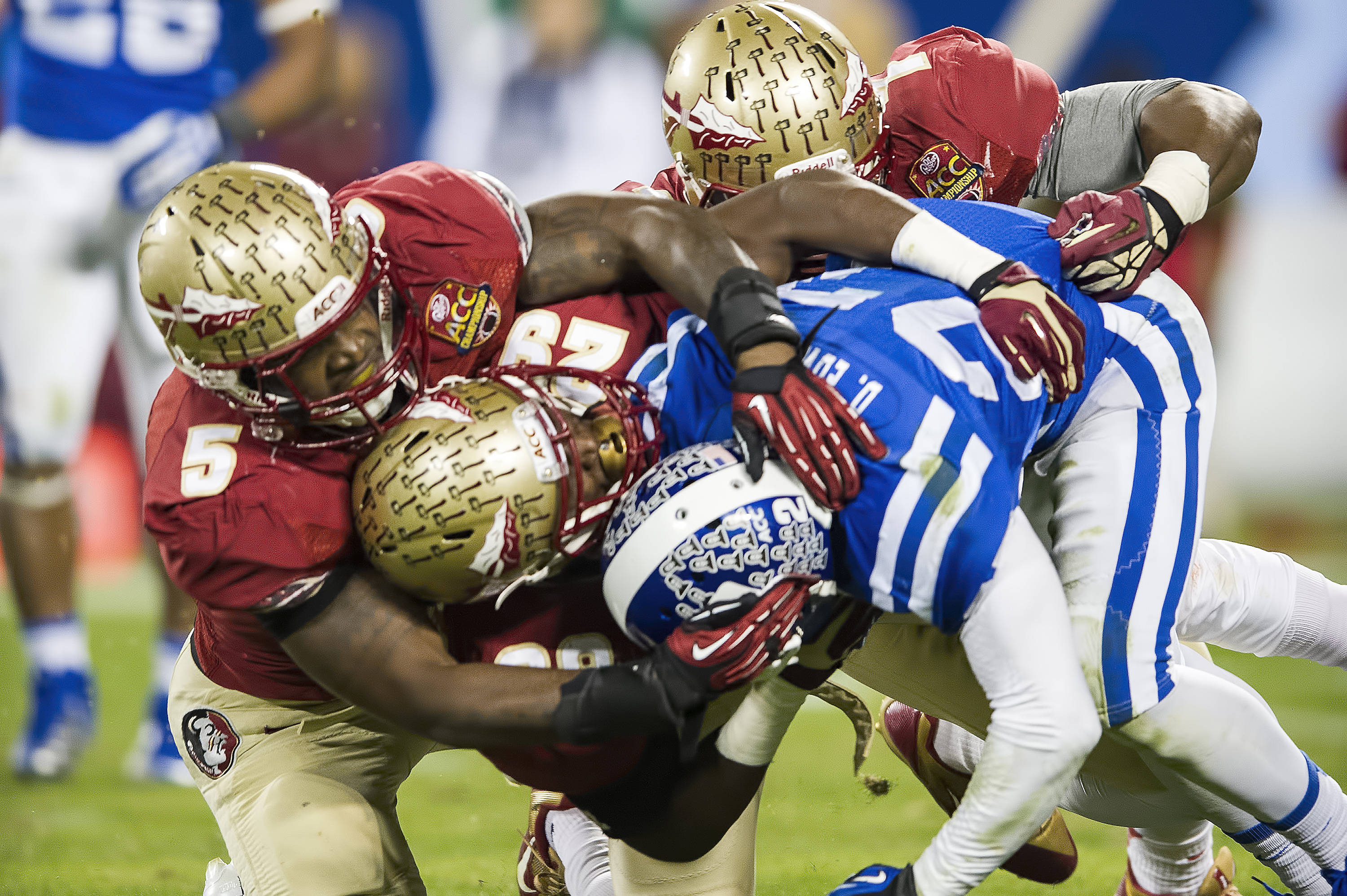 Reggie Northrup and Nate Andrews clamp down on a Duke running back