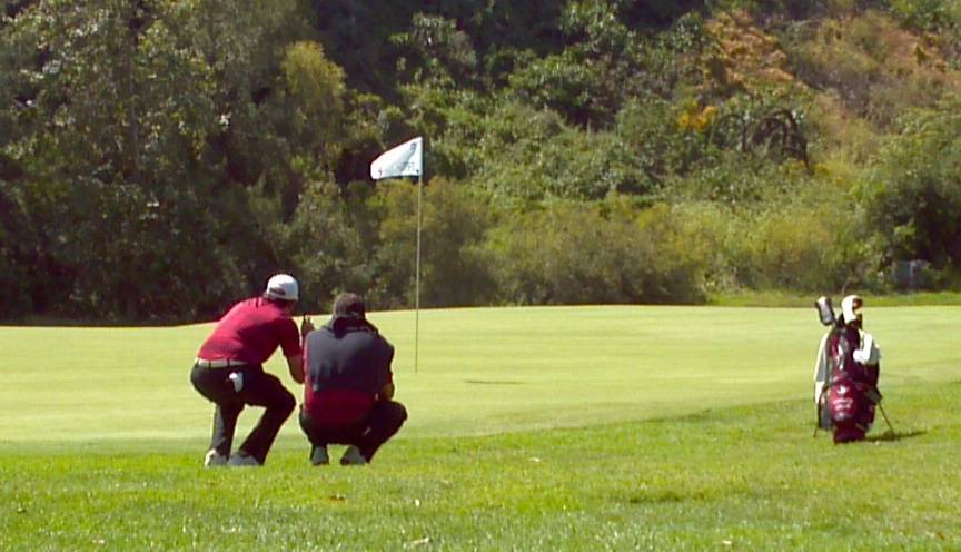 Joaquin Lolas sizes up a putt in the first round of the 2012 NCAA Division I Men Golf Championships.