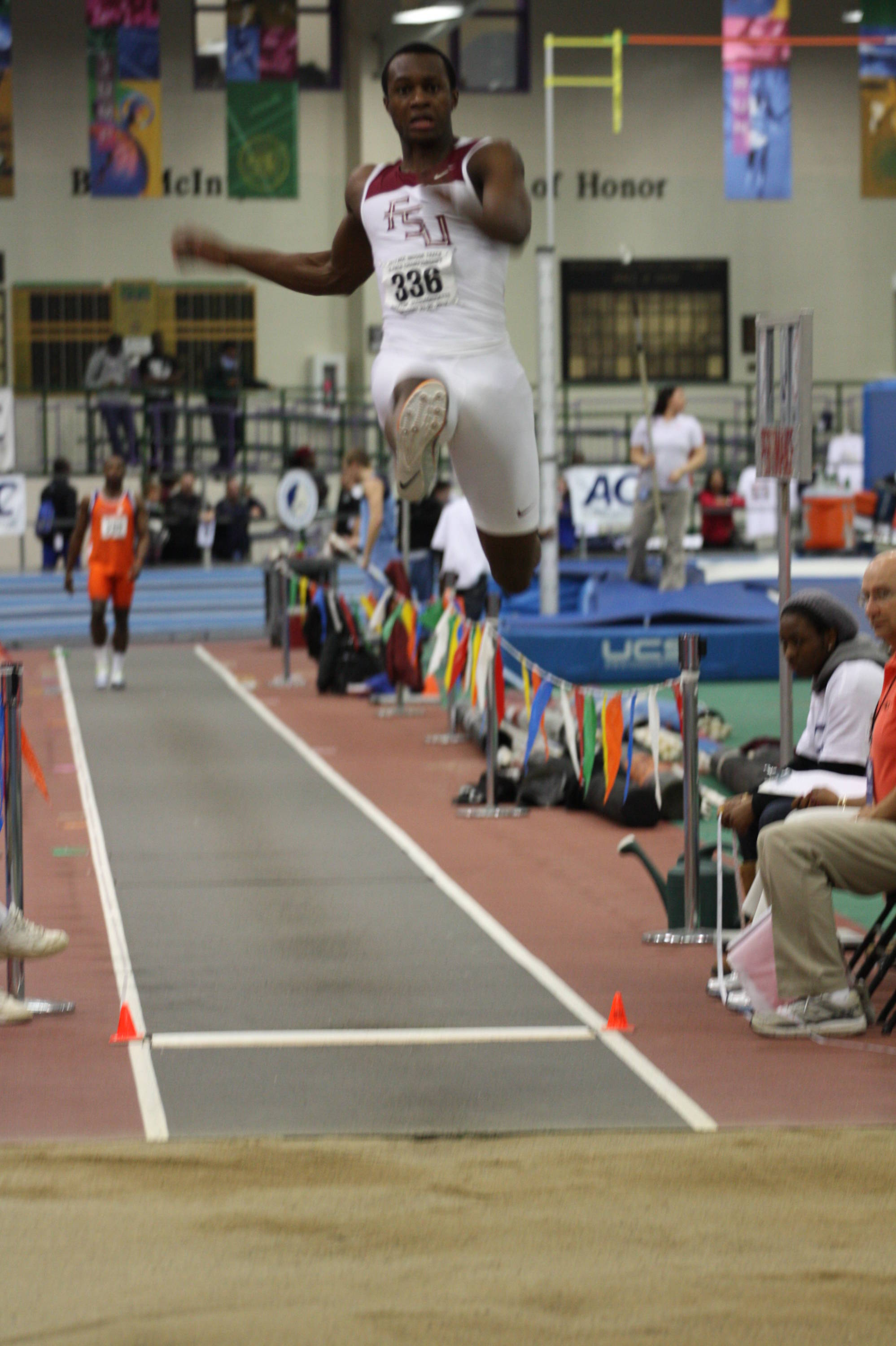 Paul Madzivire soars in the long jump ...