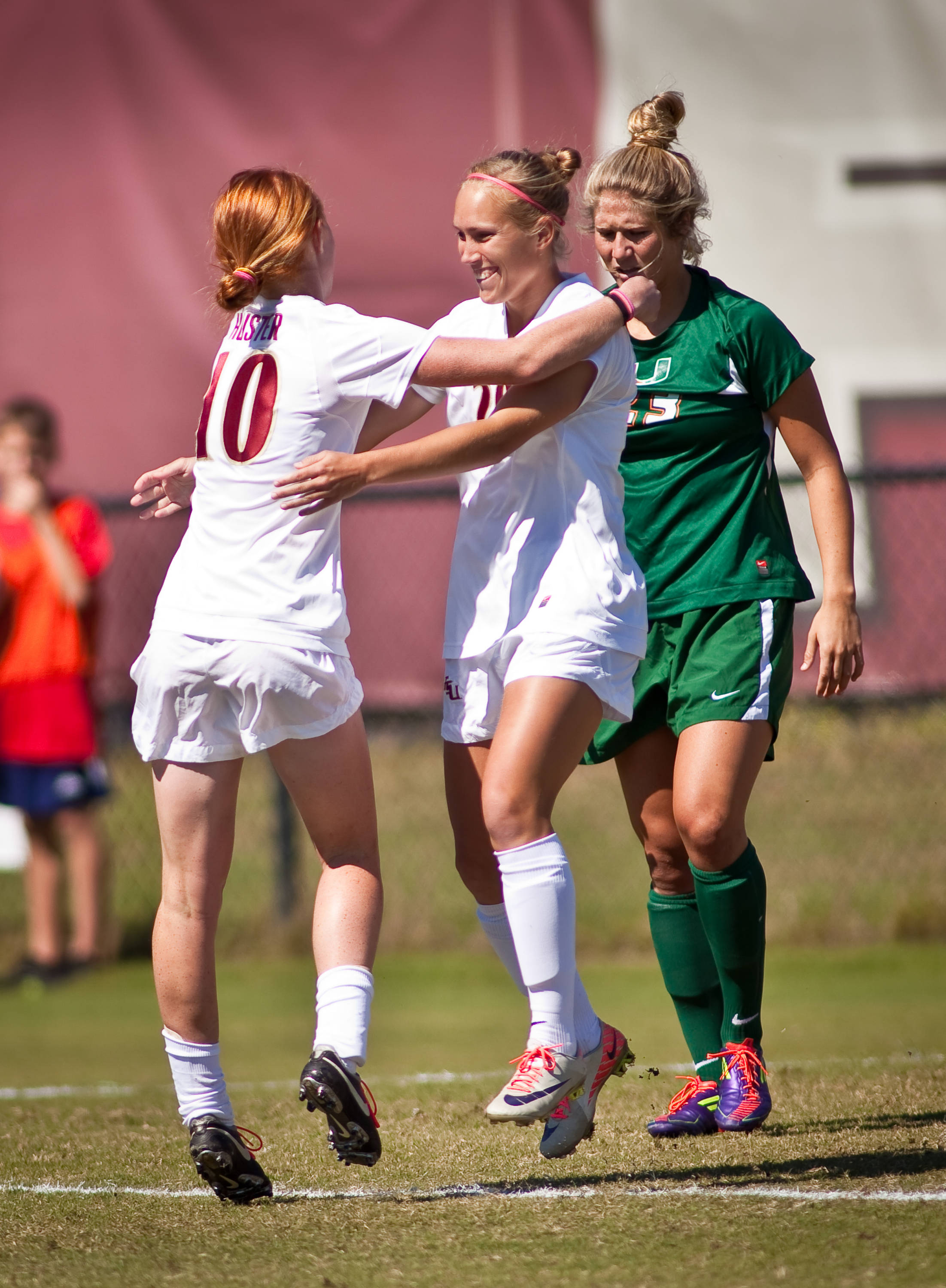 Janice Cayman and Tori Huster celebrate after the Seminoles' first goal of the game.