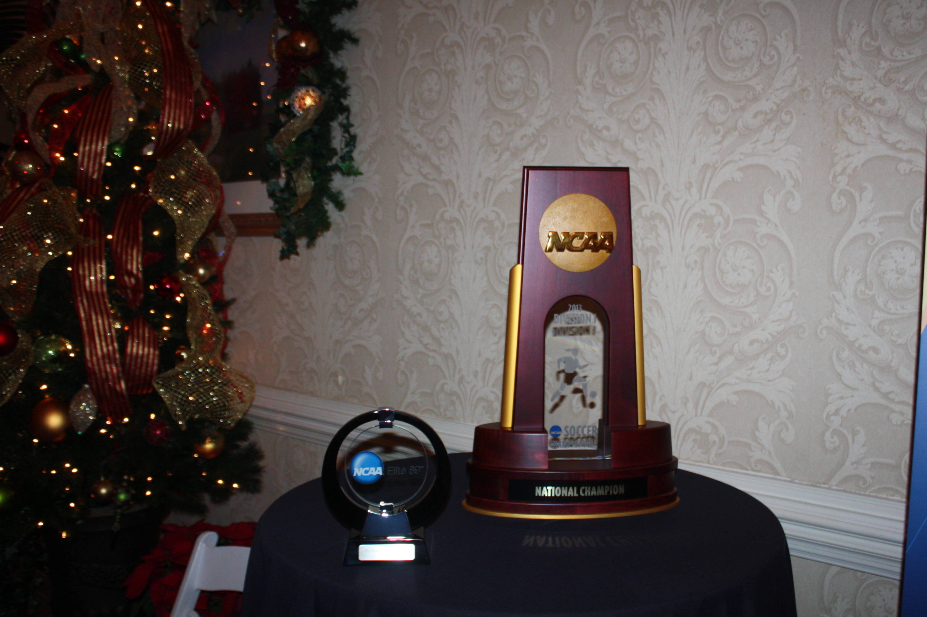 The national championship trophy and the Elite 89 Award.