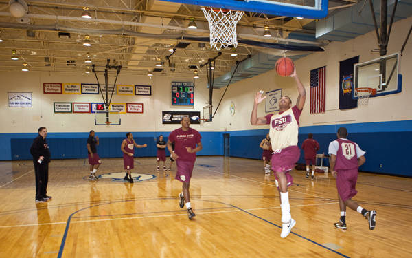 Freshman Pierre Jordan lays a ball in during the team's afternoon practice at Hilbert College.