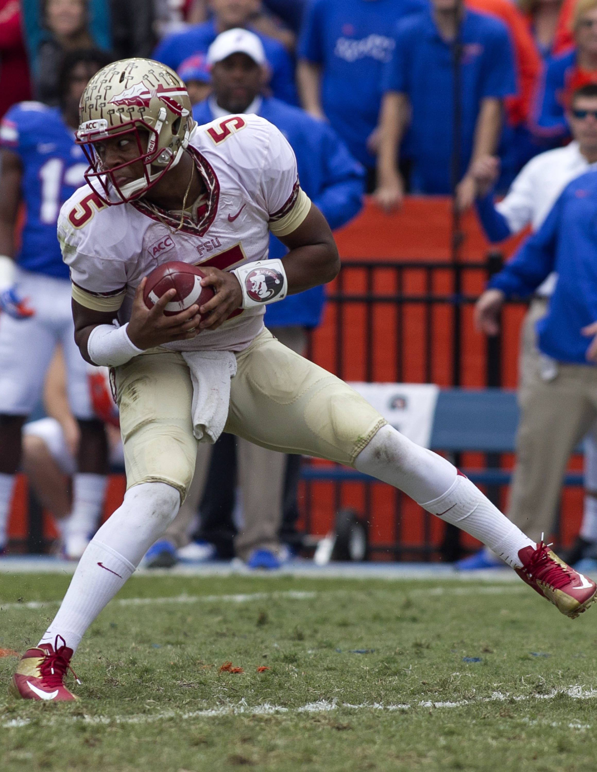 Jameis Winston (5) with a scramble, FSU vs Florida, 11-30-13,  (Photo by Steve Musco)