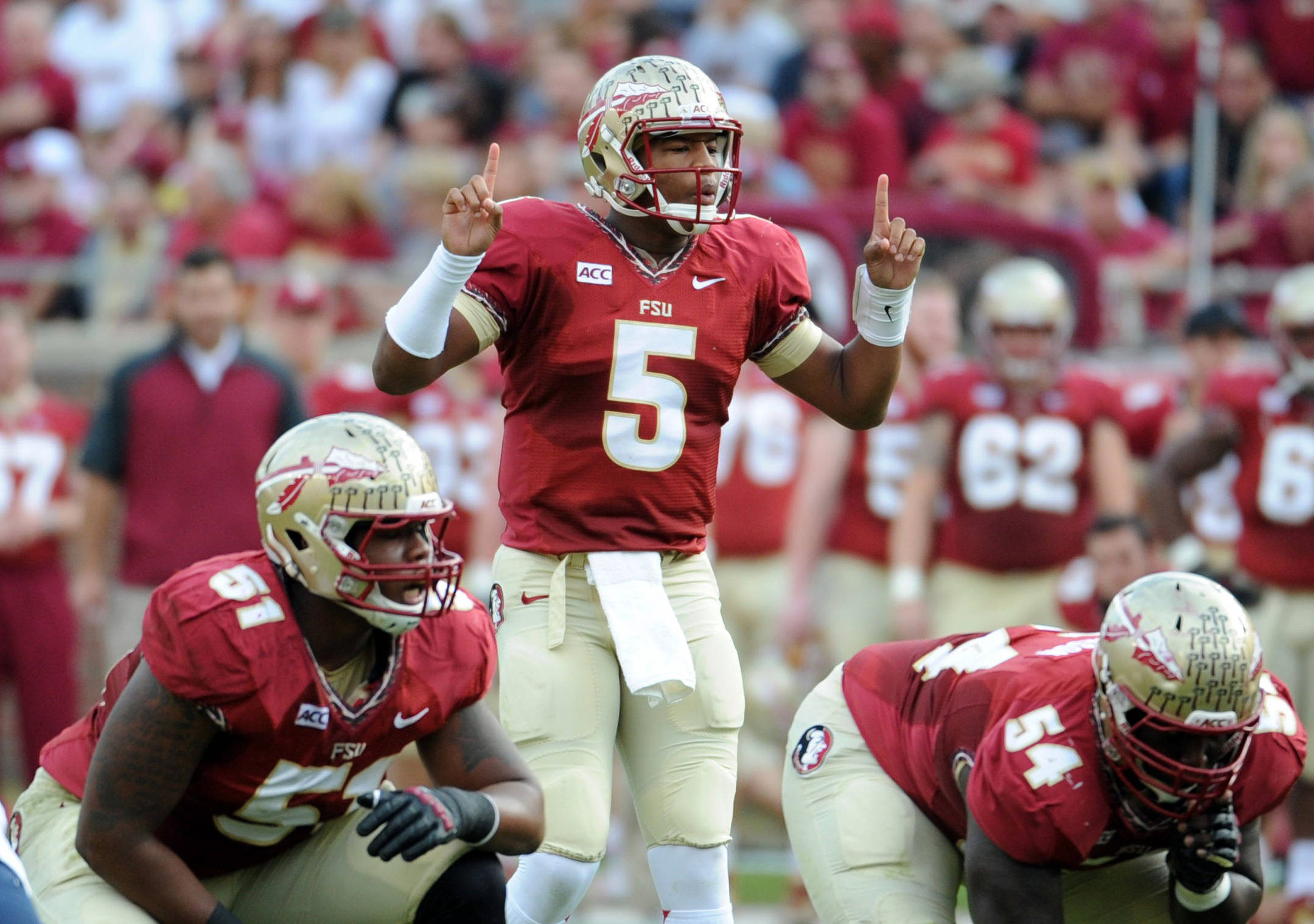 Jameis Winston (5) signals an audible during the first half. Mandatory Credit: Melina Vastola-USA TODAY Sports
