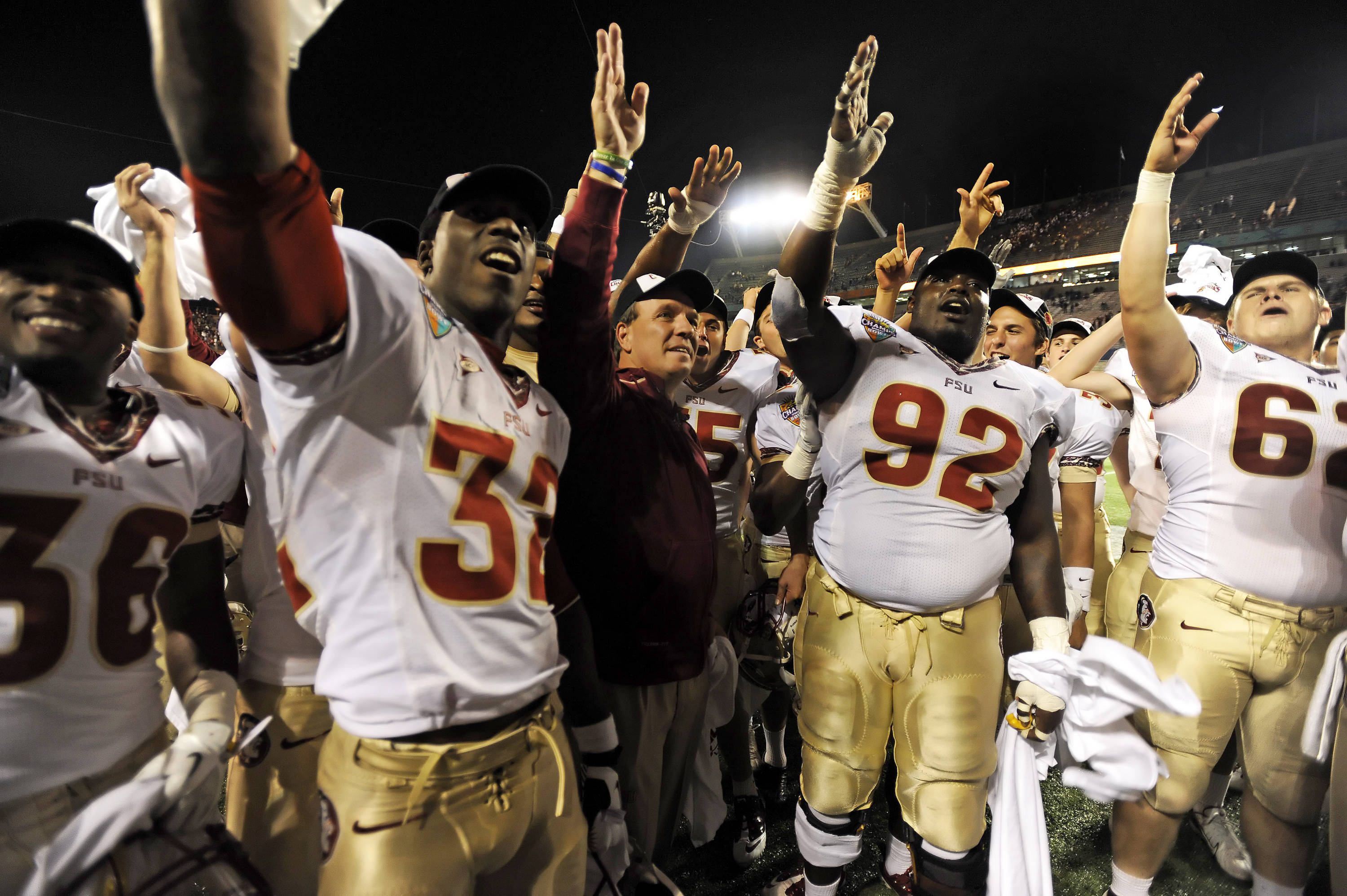 Jimbo Fisher and players celebrate after the victory over Notre Dame in the Champs Sports Bowl