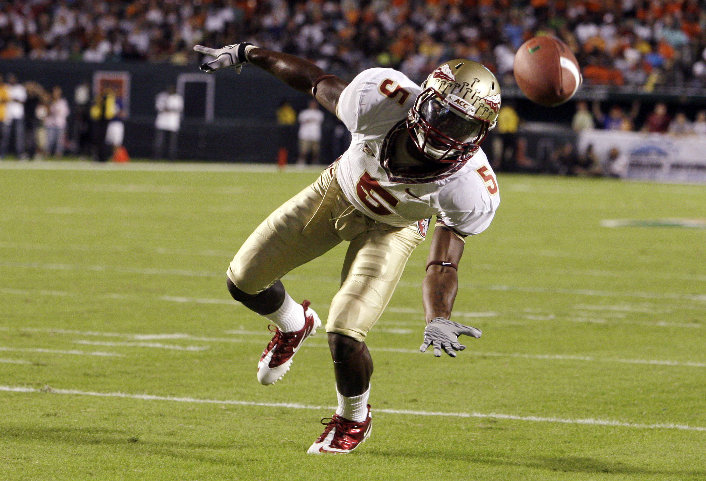 Florida State cornerback Greg Reid can't make the catch for an interception on a pass thrown by Miami quarterback Jacory Harris.