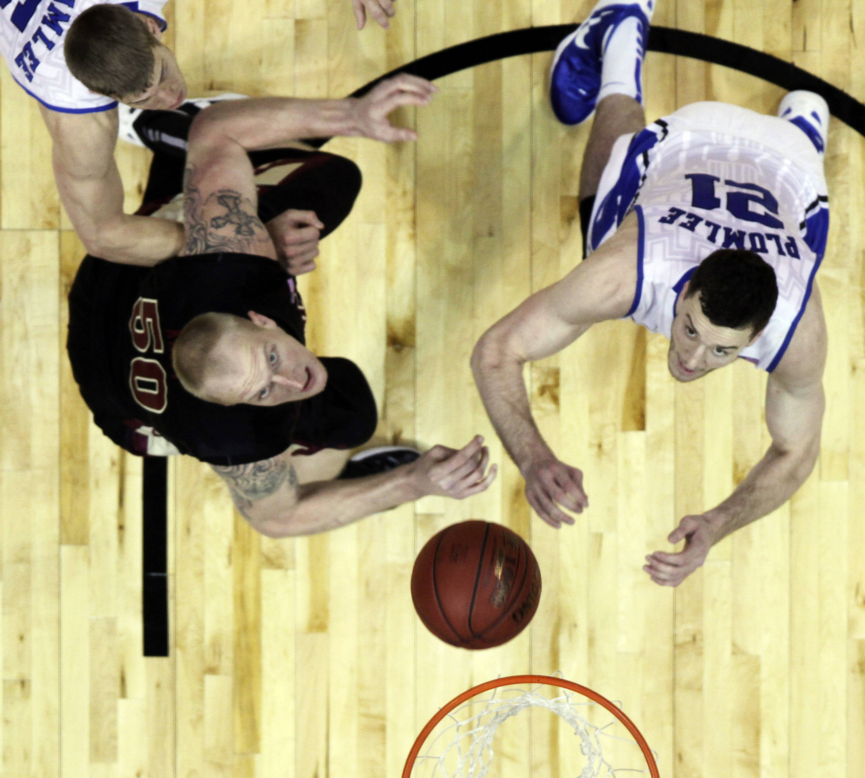 Duke forward Alex Murphy (12) and Florida State center Jon Kreft (50) wait for a rebound as Duke forward Miles Plumlee looks on during the first half of an NCAA college basketball game in the semifinals of the Atlantic Coast Conference tournament, Saturday, March 10, 2012, in Atlanta. (AP Photo/John Bazemore)