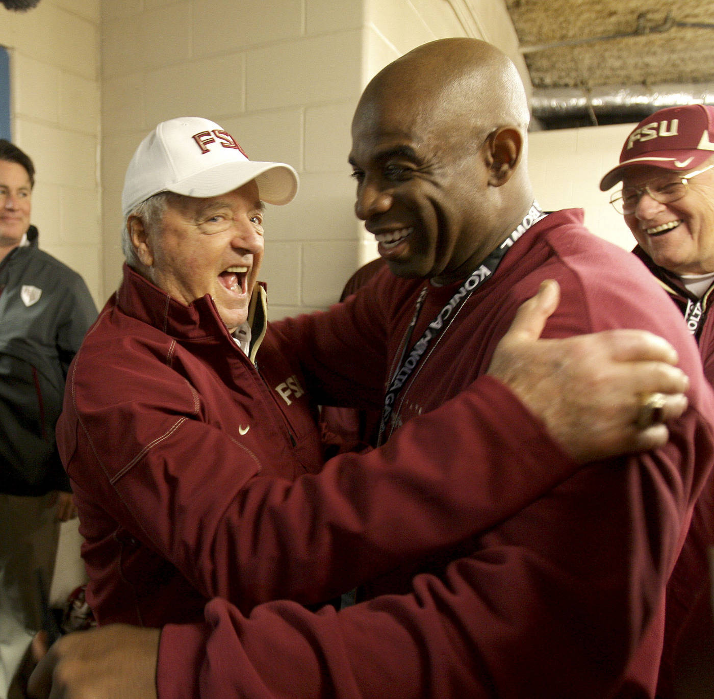Florida State head coach Bobby Bowden, left, visits with former Seminole football player Deion Sanders in the locker room prior to the Gator Bowl NCAA college football game against West Virginia,  Friday, Jan. 1, 2010, in Jacksonville, Fla. (AP Photo/Phil Coale)