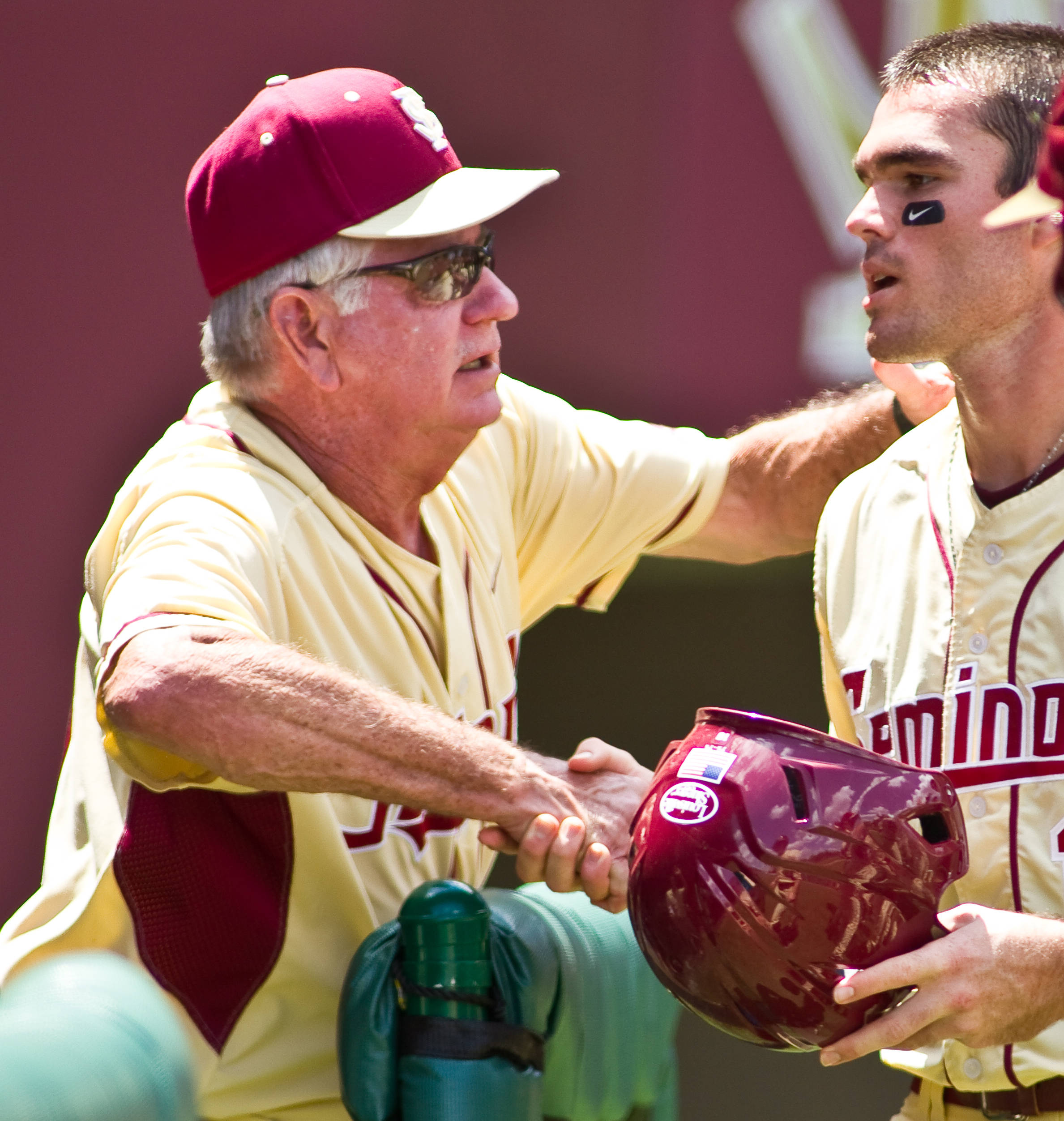 Mike Martin congratulates Jayce Boyd on a run scored in Sunday's win.