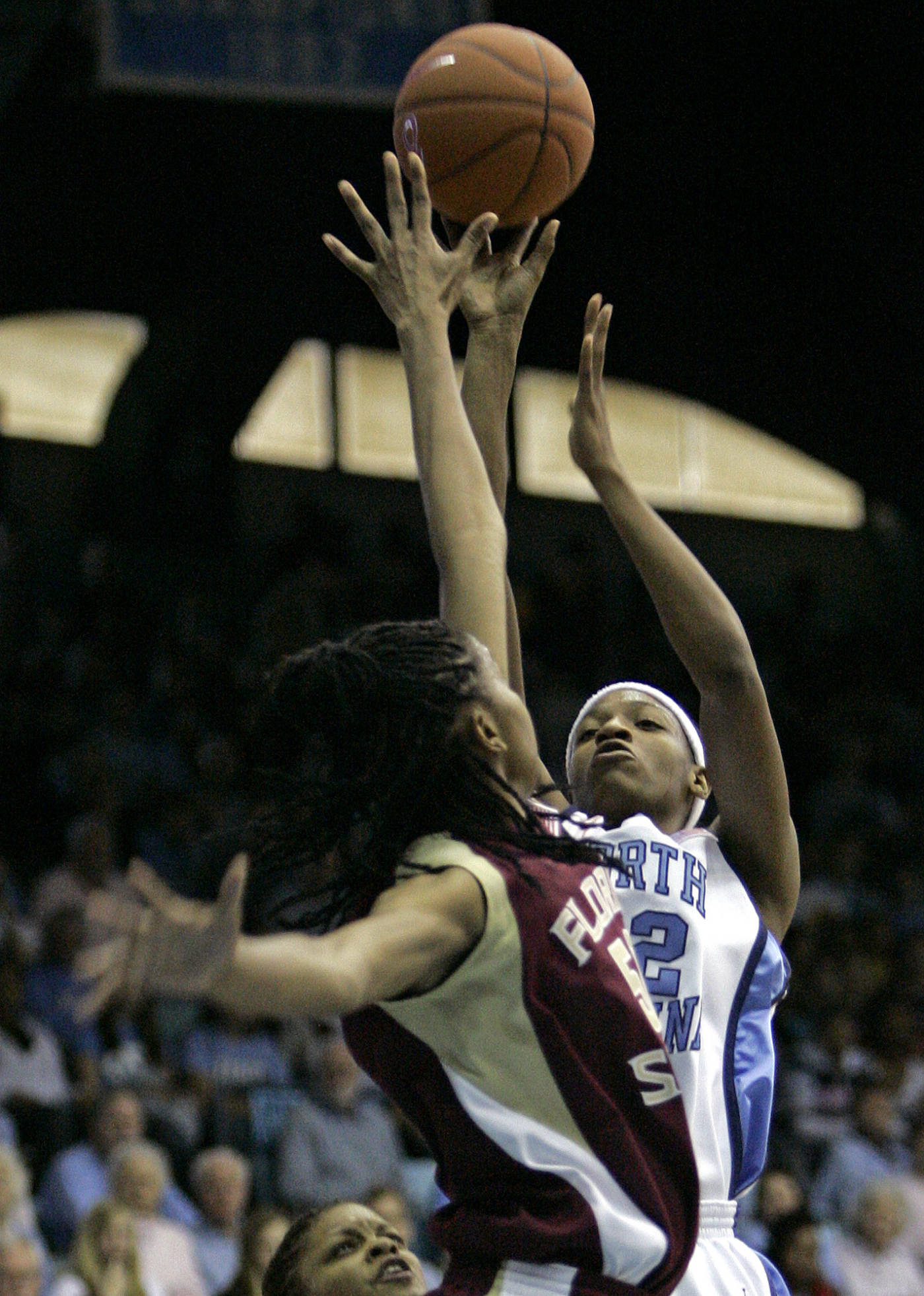 North Carolina's Rashanda McCants, right, shoots as Florida State's Jacinta Monroe defends during the first half of a college basketball game in Chapel Hill, N.C., Sunday, Feb. 17, 2008. (AP Photo/Gerry Broome)
